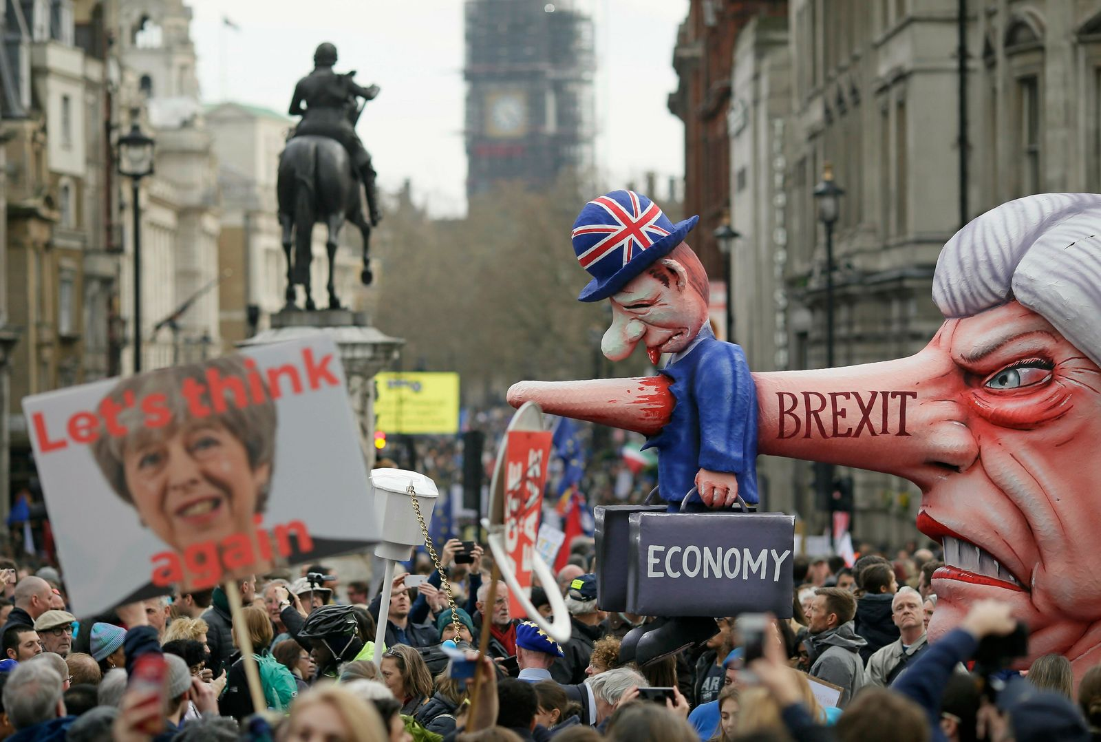 An effigy of British Prime Minister Theresa May is wheeled through Trafalgar Square during a Peoples Vote anti-Brexit march in London, Saturday, March 23, 2019.. (AP Photo/Tim Ireland)