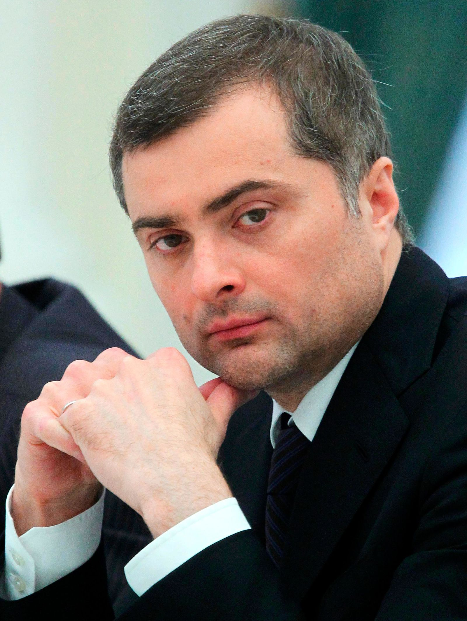 FILE - In this Wednesday, May 8, 2013 file photo Vladislav Surkov, an adviser to Russian President Vladimir Putin listens, during a meeting in Moscow, Russia.{ } (Mikhail Klimentyev, Sputnik, Kremlin Pool Photo via AP, File)