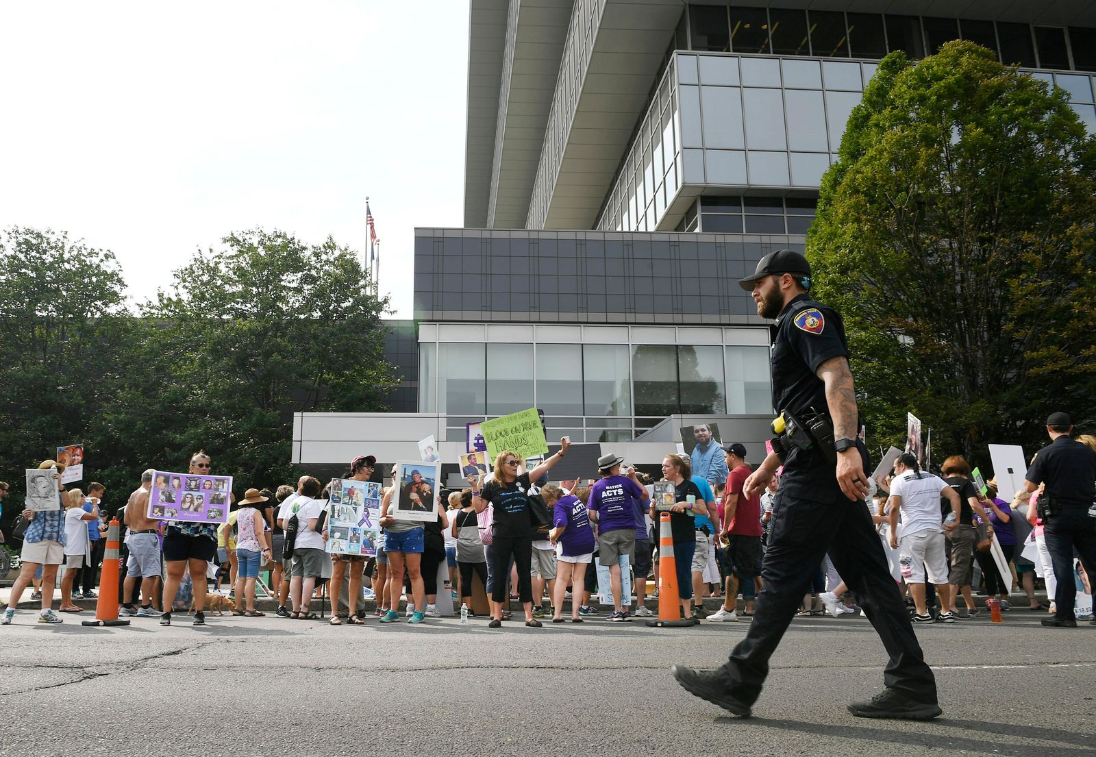 In this Aug. 17, 2018 file photo, family and friends who have lost loved ones to OxyContin and opioid overdoses protest outside Purdue Pharma headquarters in Stamford, Conn.{ } (AP Photo/Jessica Hill, File)
