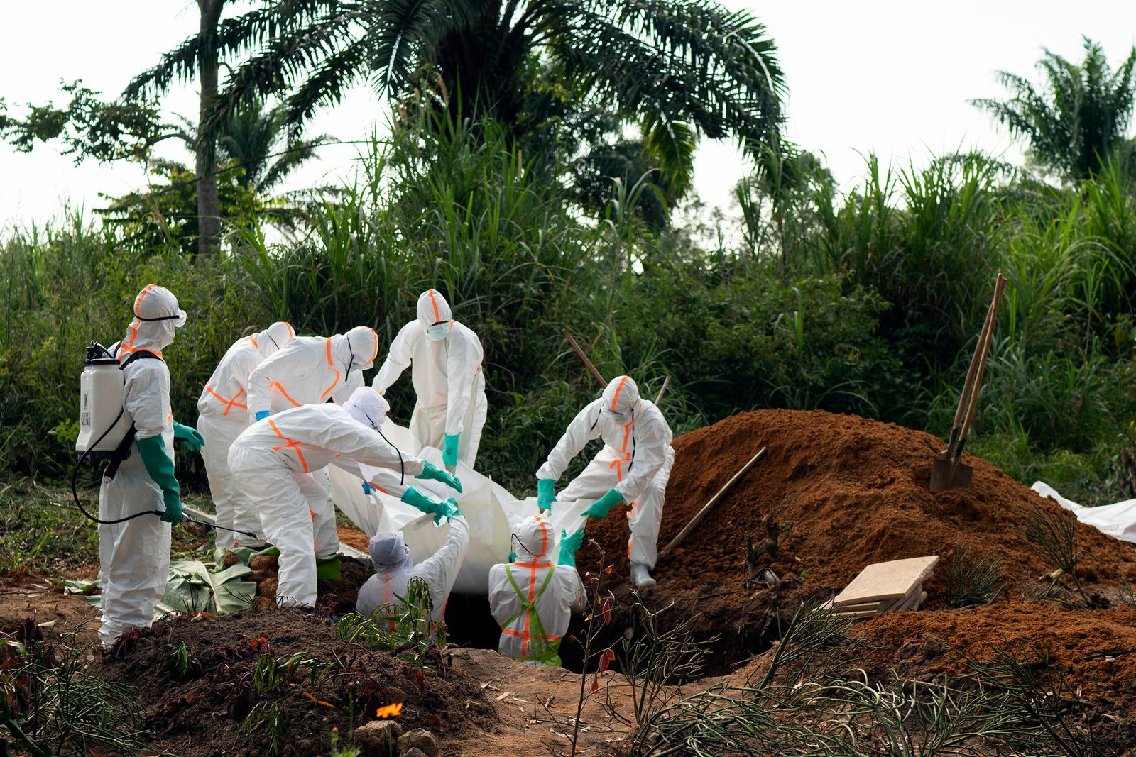In this photograph taken Sunday July 14, 2019, an Ebola victim is put to rest at the Muslim cemetery in Beni, Congo DRC. (AP Photo/Jerome Delay)