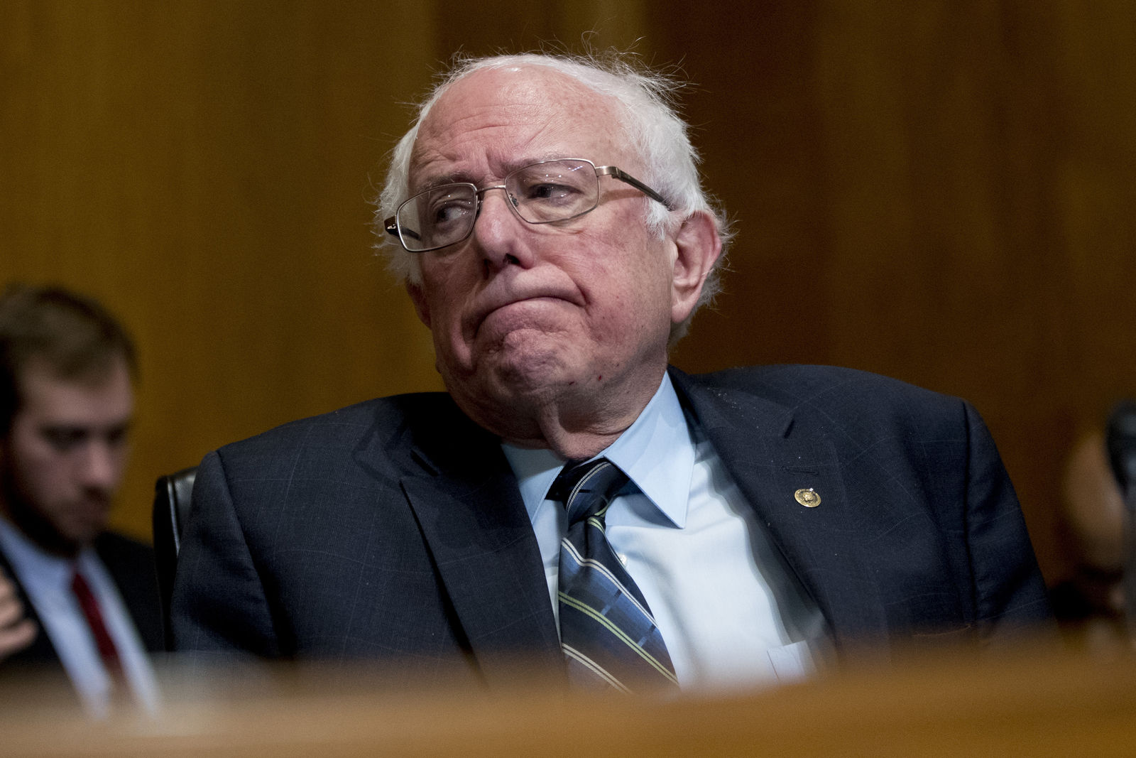 Sen. Bernie Sanders, I-Vt., reacts after questioning Andrew Wheeler as he testifies at a Senate Environment and Public Works Committee hearing to be the administrator of the Environmental Protection Agency, on Capitol Hill in Washington, Wednesday, Jan. 16, 2019. (AP Photo/Andrew Harnik)