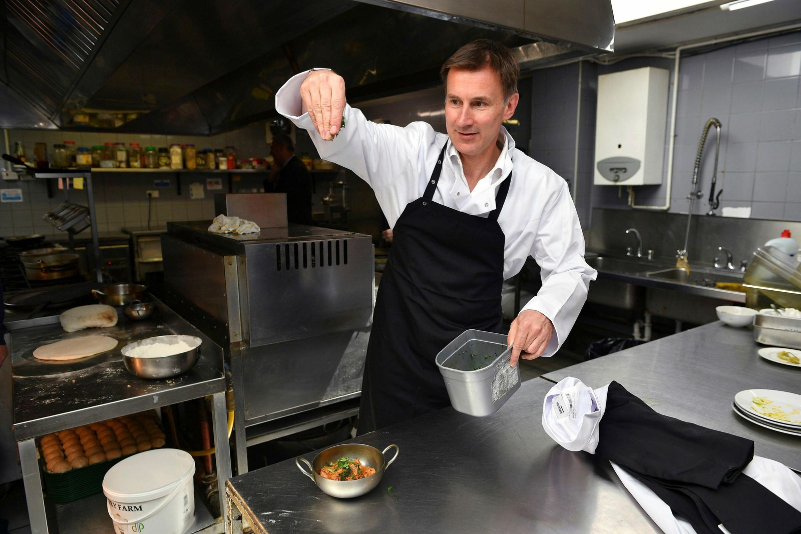 Conservative Party leadership candidate Jeremy Hunt visits Imran's Balti Restaurant ahead of the first Tory party hustings, in Birmingham, England, Saturday June 22, 2019. (Ben Birchall/PA via AP)