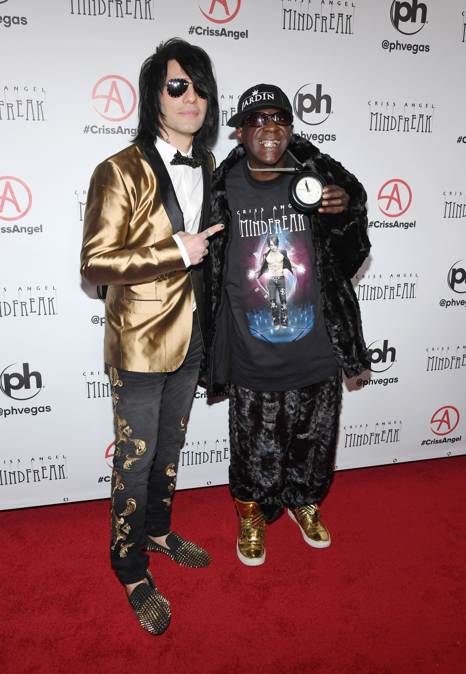 "LAS VEGAS, NEVADA - JANUARY 19:  Illusionist Criss Angel (L) and rapper Flavor Flav attend the grand opening of ""Criss Angel MINDFREAK"" at Planet Hollywood Resort & Casino on January 19, 2019 in Las Vegas, Nevada.  (Photo by Ethan Miller/Getty Images for Planet Hollywood Resort & Casino)"