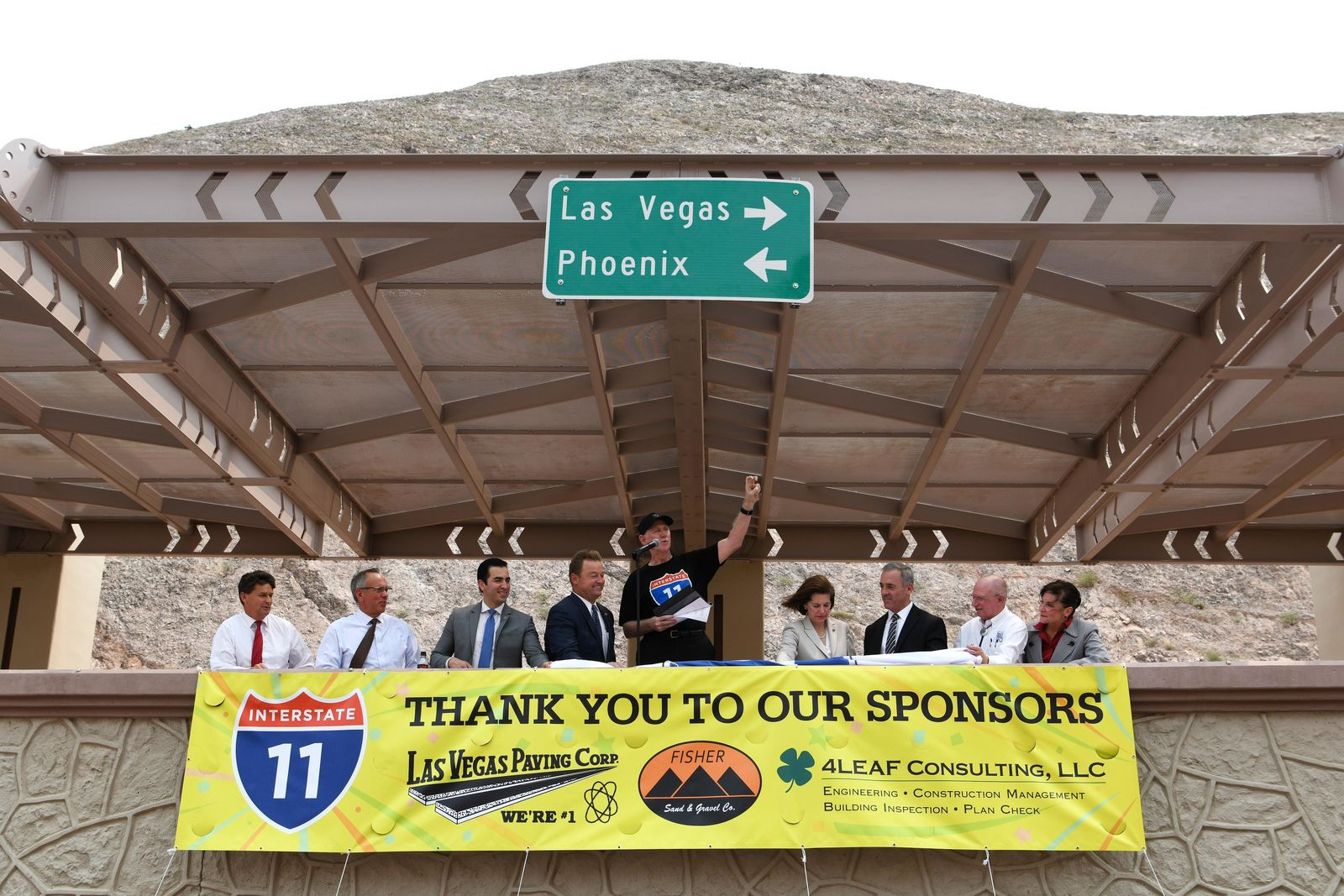 Elected officials take part in the grand opening of a new section of Interstate 11 Thursday, August 9, 2018, in Boulder City. From left are Boulder City Mayor Rod Woodbury, Clark County Commissioner Jim Gibson, Rep. Ruben Kihuen, D-Nev., Sen. Dean Heller, R-Nev., Clark County Commissioner Larry Brown, Sen. Catherine Cortez Masto, D-Nev., Federal Highway Administration Director of Field Services West Peter Osborn, Nevada State Sen. Joe Hardy, and Las Vegas Chamber of Commerce President Mary Beth Sewald. The section, also referred to as the Boulder City Bypass, marks the official start of the I-11 project between Las Vegas and Phoenix. CREDIT: Sam Morris/Las Vegas News Bureau