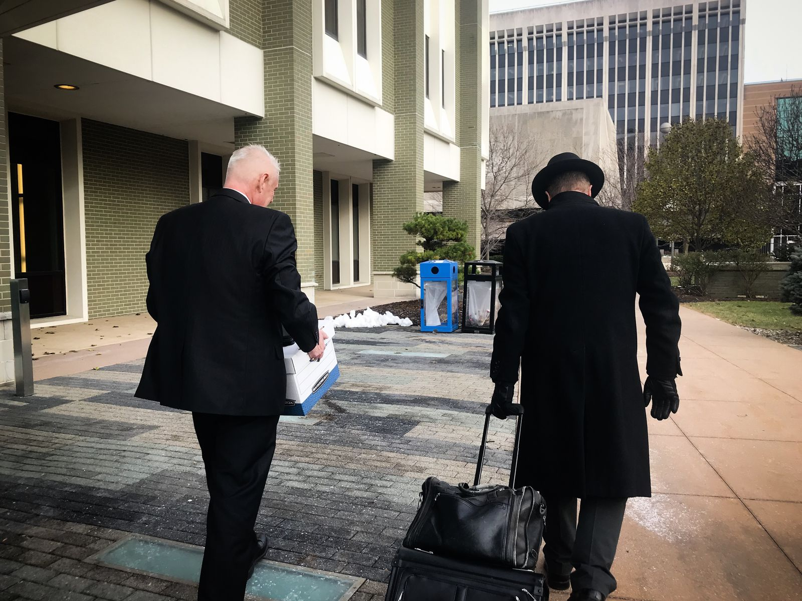 Michigan state Rep. Larry Inman, R-Williamsburg, and his attorney, Chris Cooke, leave the federal courthouse in Grand Rapids on Thursday, Dec. 5, 2019. (SBG/Mikenzie Frost)