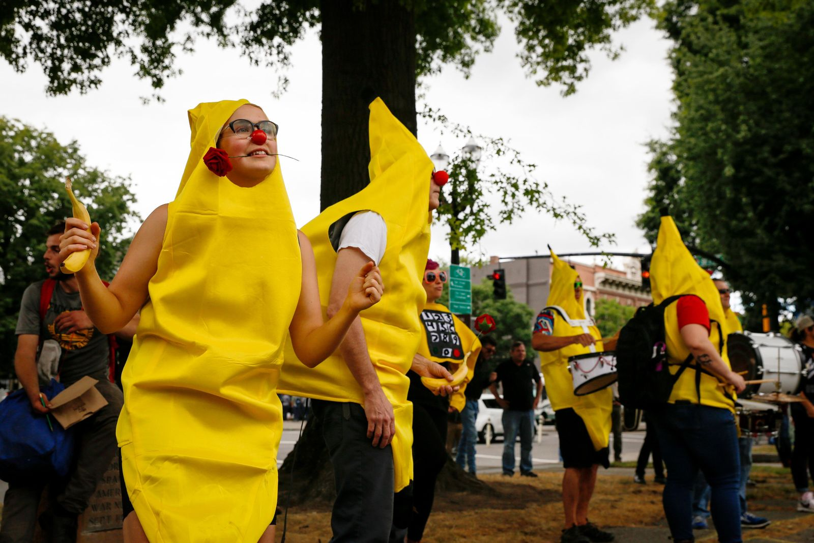 "A ""Banana Bloc Dance Party"" gathering is held near Battleship Oregon Memorial Marine Park on Saturday, Aug. 17, 2019, in downtown Portland, Ore. Hundreds of far-right protesters and anti-fascist counter-demonstrators swarmed the downtown area, as police set up concrete barriers and closed streets and bridges in an effort to contain and separate the rival groups. (AP Photo/Moriah Ratner)"