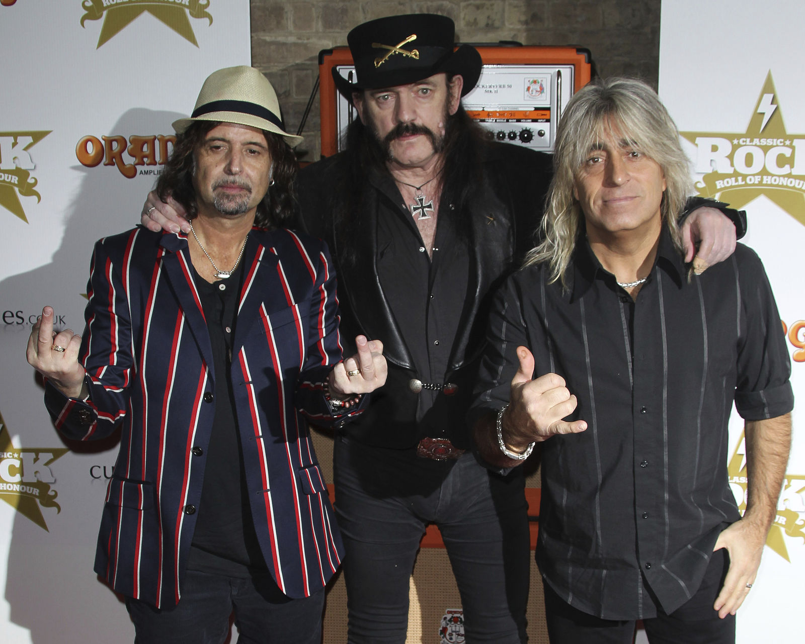 FILE - This Nov. 13, 2012 file photo shows, from left, Phil Campbell, Lemmy Kilmister, and Mikkey Dee, of Motorhead, at the Classic Rock Roll of Honour Awards at the Roundhouse venue in Camden, north London.  Motorhead are among the 16 acts nominated for the Rock and Roll Hall of Fame's 2020 class. Kilmister died on on Dec. 28, 2015. (Photo by Joel Ryan/Invision/AP, File)