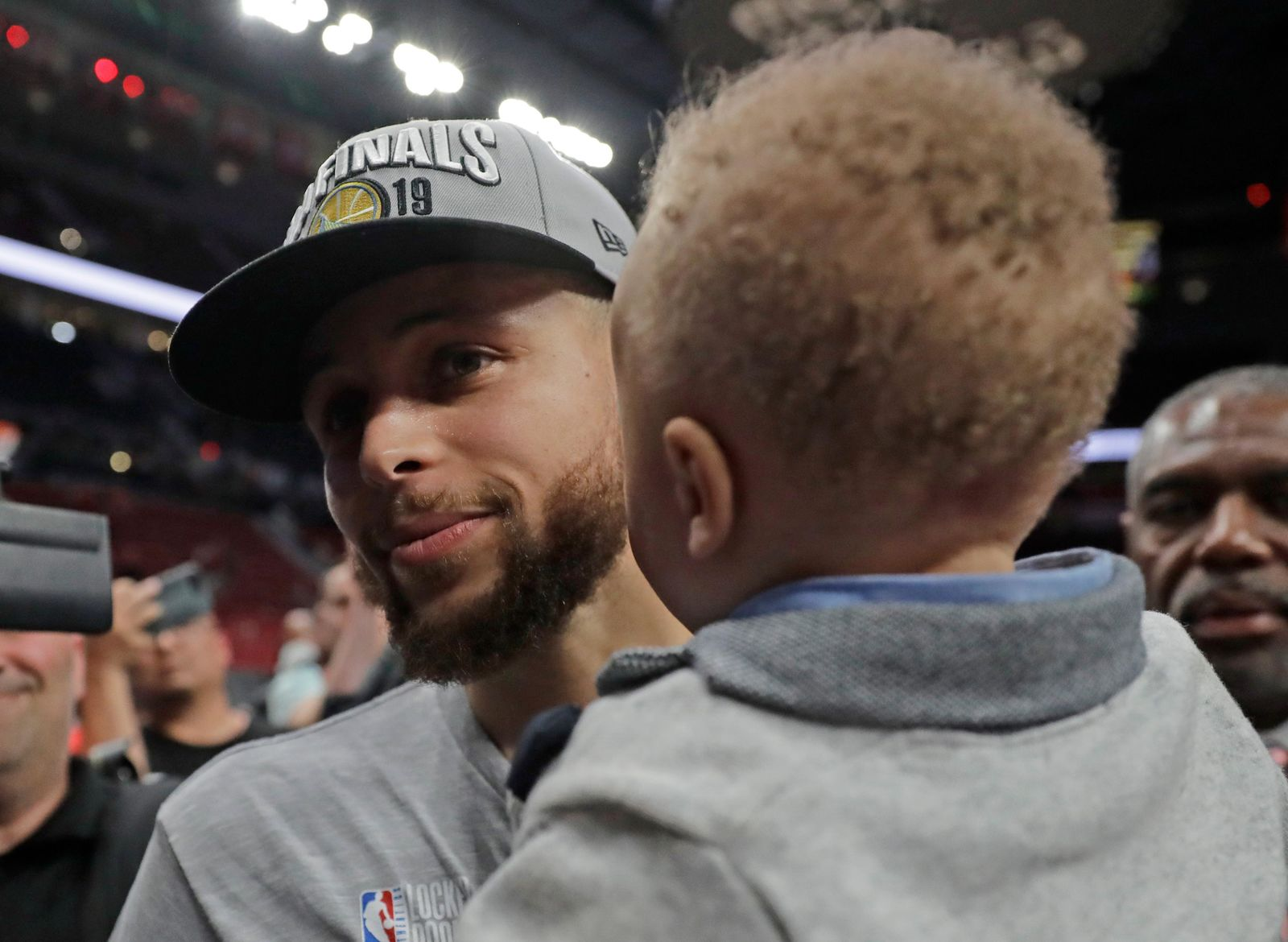 Golden State Warriors guard Stephen Curry holds his son Canon as he walks off the court after Game 4 of the NBA basketball playoffs Western Conference finals against the Portland Trail Blazers, Monday, May 20, 2019, in Portland, Ore. The Warriors won 119-117 in overtime. (AP Photo/Ted S. Warren)
