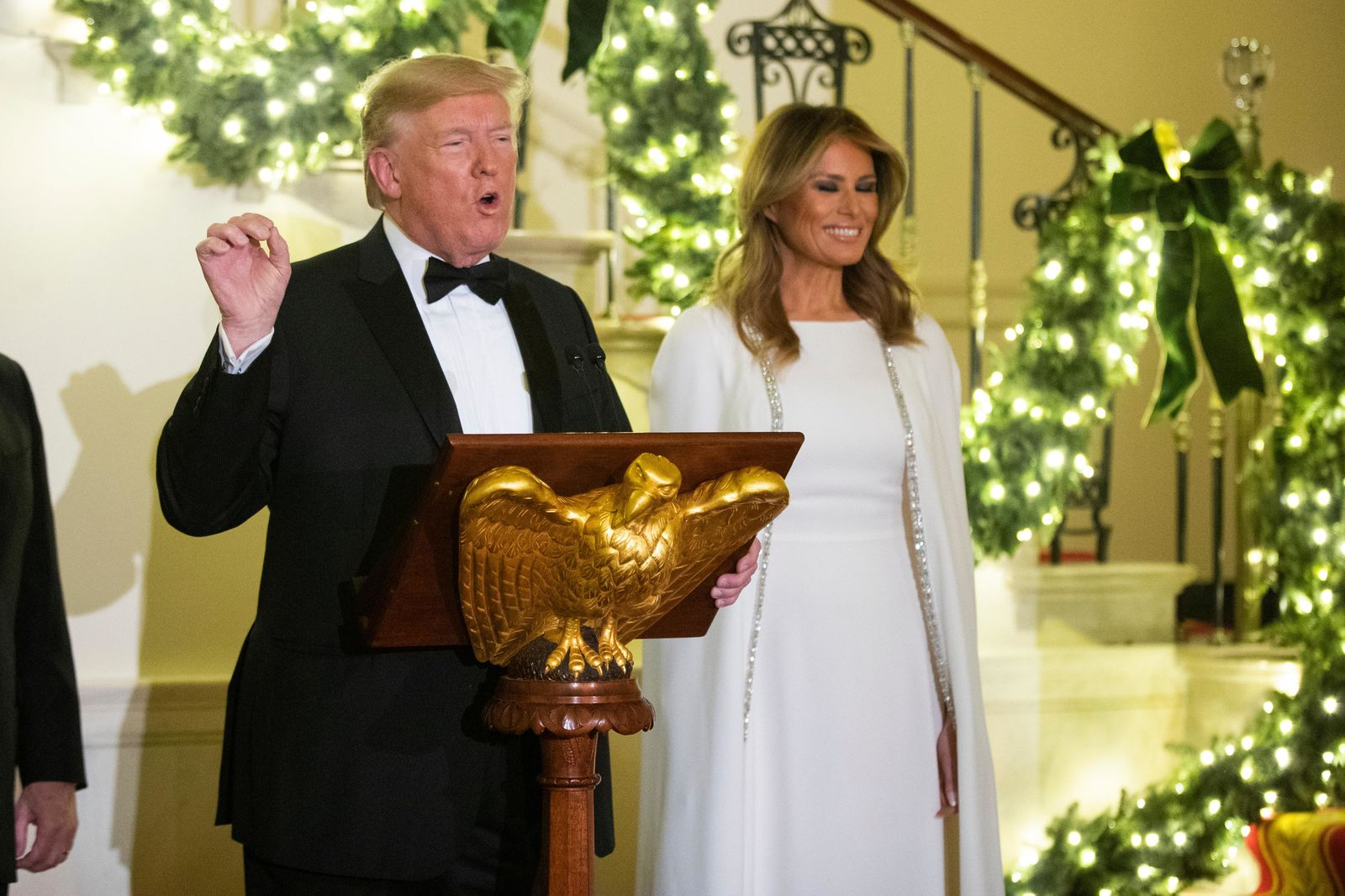 President Donald Trump with first lady Melania Trump speaks at the Grand Foyer of the White House during the Congressional Ball, Thursday, Dec. 12, 2019, in Washington. (AP Photo/Manuel Balce Ceneta)