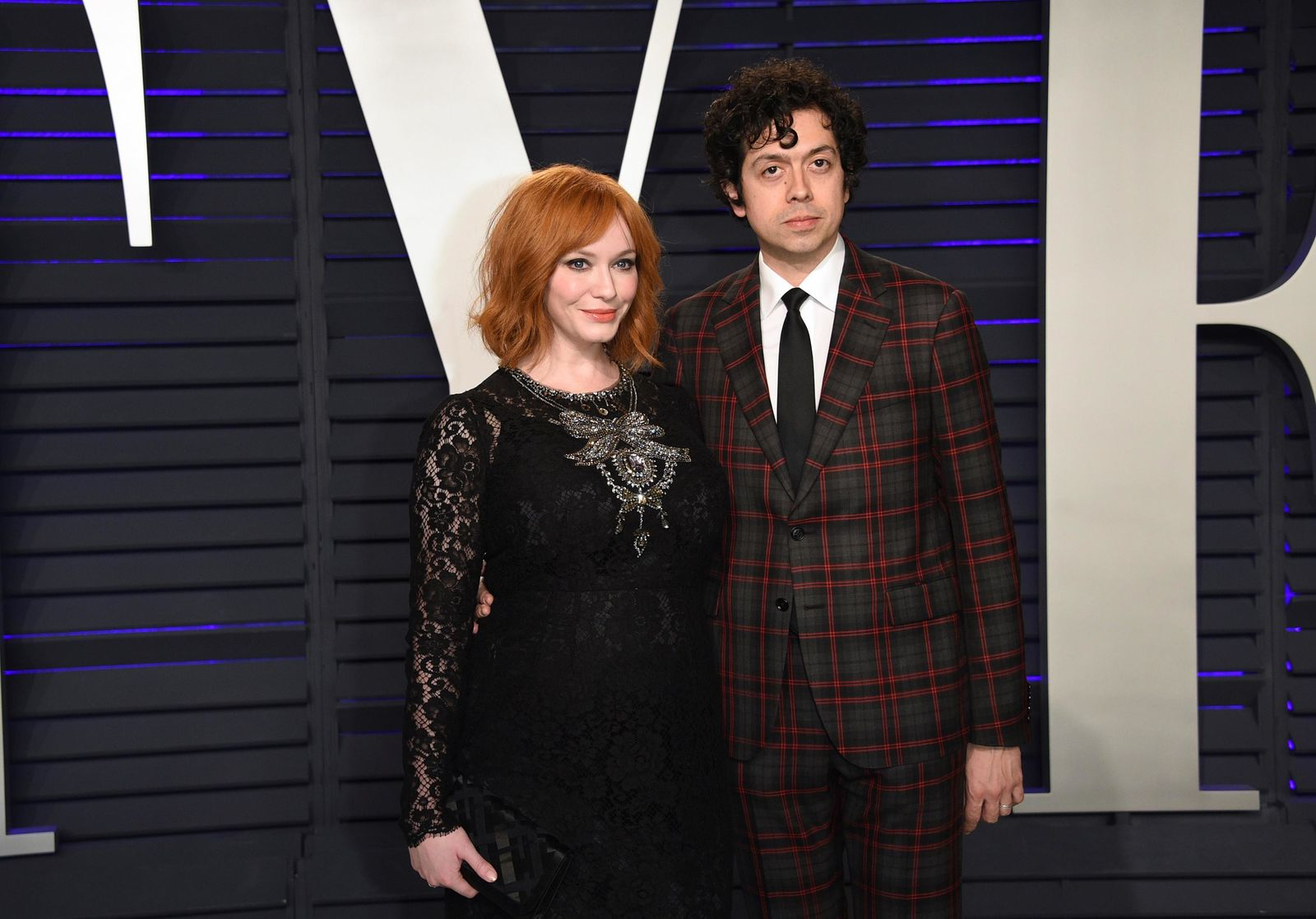 FILE - In this Feb. 24, 2019 file photo, Christina Hendricks, left, and Geoffrey Arend arrive at the Vanity Fair Oscar Party in Beverly Hills, Calif. Hendricks filed for divorce Friday, Dec. 13,  from her husband of 10 years, actor Geoffrey Arend. (Photo by Evan Agostini/Invision/AP, File)
