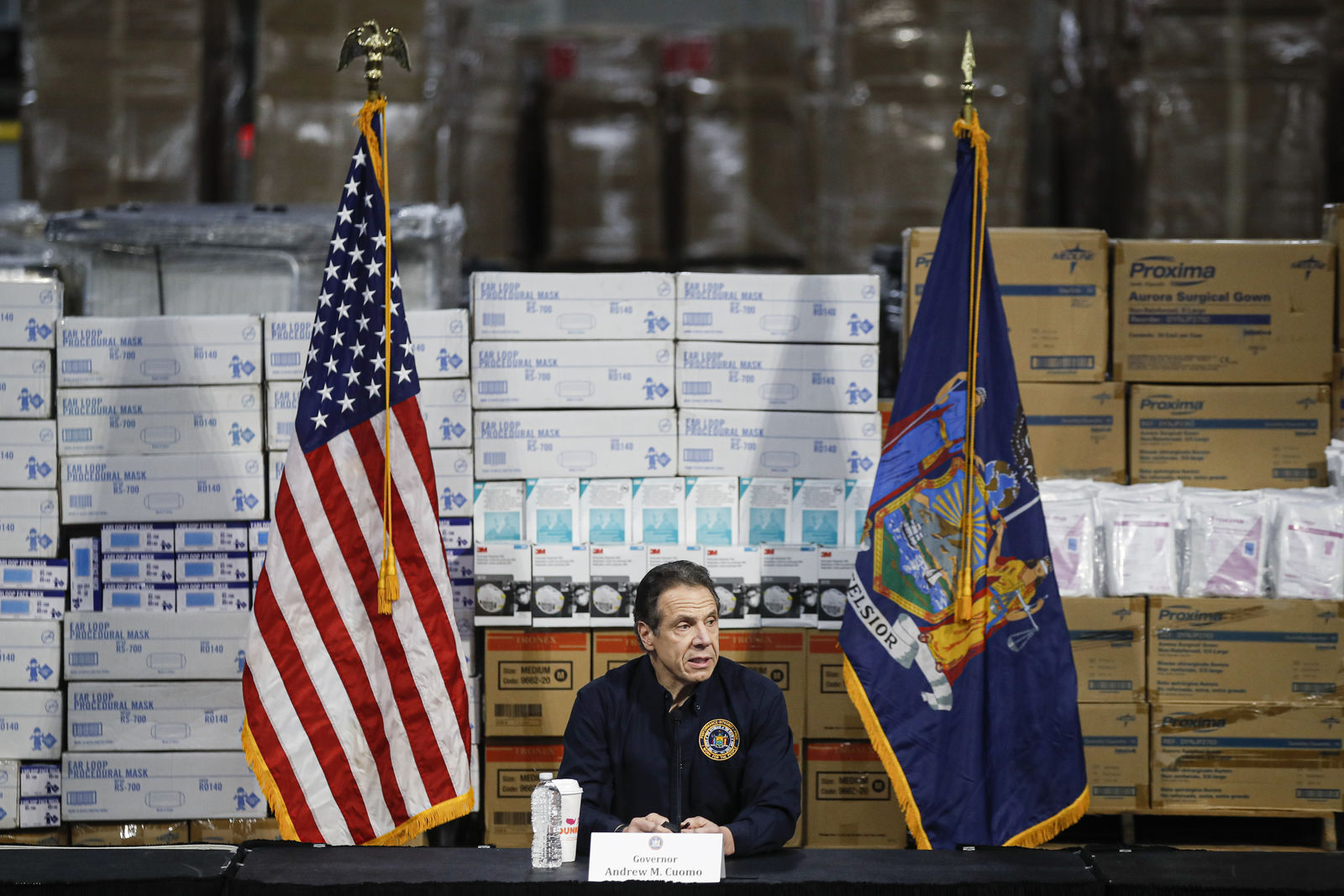 FILE - In this Tuesday, March 24, 2020 file photo, Gov. Andrew Cuomo speaks during a news conference against a backdrop of medical supplies at the Jacob Javits Center that will house a temporary hospital in response to the COVID-19 outbreak in New York. . (AP Photo/John Minchillo)