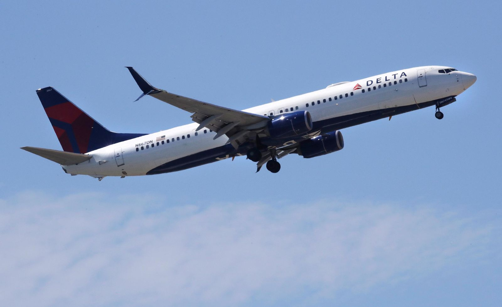 FILE- In this May 24, 2018, file photo a Delta Air Lines passenger jet plane, a Boeing 737-900 model, approaches Logan Airport in Boston. (AP Photo/Charles Krupa, File)