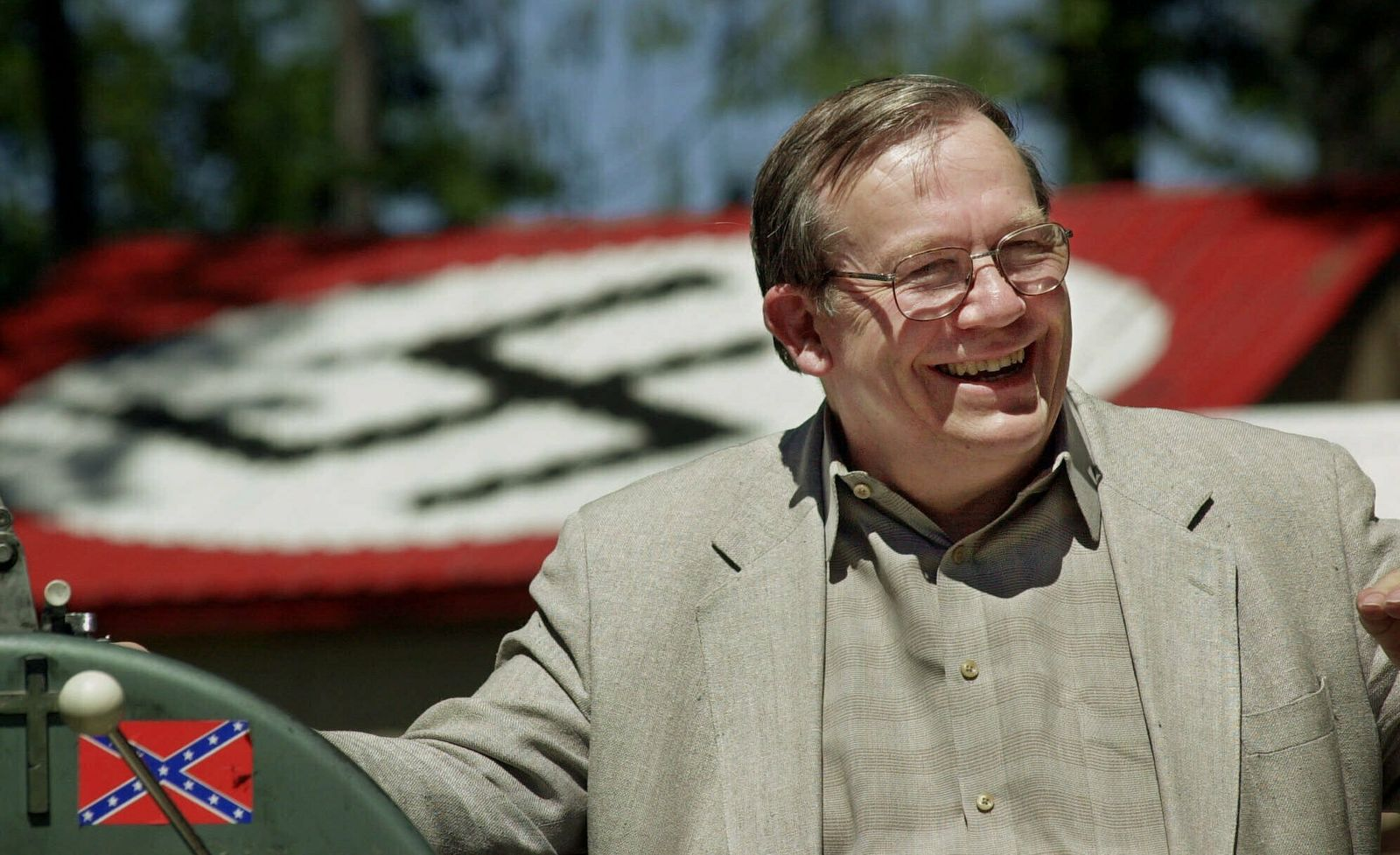 FILE - In this May 22, 2001, file photo, Norm Gissel smiles as he talks about the imminent dismantling of the former headquarters of the Aryan Nations in Hayden Lake, Idaho. (AP Photo/Elaine Thompson, File)