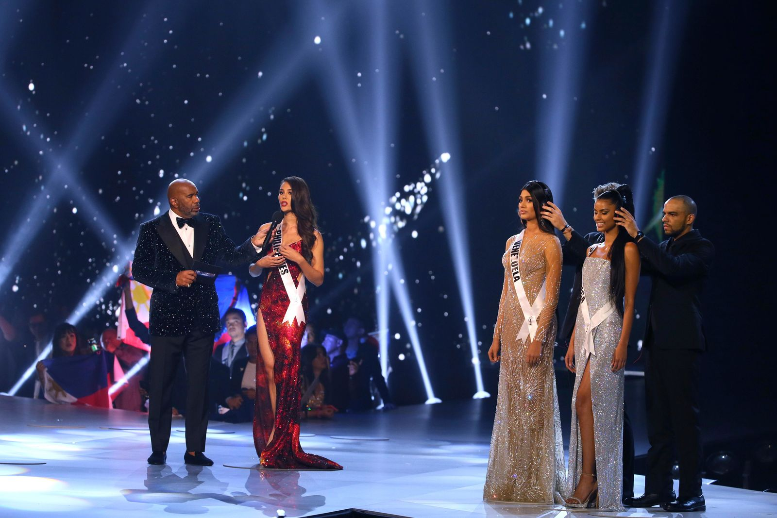 Miss Philippines Catriona Gray, second from left, is interviewed by the host during the final of 67th Miss Universe competition in Bangkok, Thailand, Monday, Dec. 17, 2018.(AP Photo/Gemunu Amarasinghe)