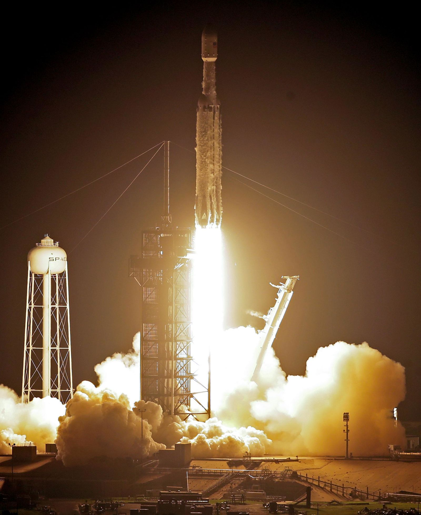 A SpaceX Falcon heavy rocket lifts off from pad 39A at the Kennedy Space Center in Cape Canaveral, Fla., early Tuesday, June 25, 2019. The Falcon rocket has a payload military and scientific research satellites. (AP Photo/John Raoux)