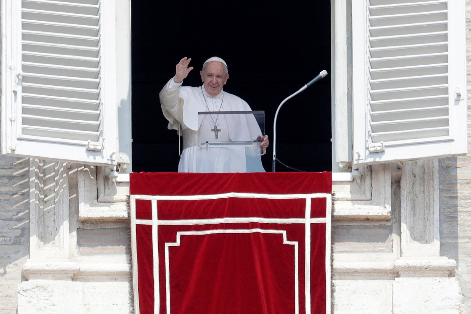 FILE – Pope Francis waves to faithful during the Angelus noon prayer in St. Peter's Square at the Vatican, Sunday, Aug. 25, 2019.{ } (AP Photo/Gregorio Borgia)