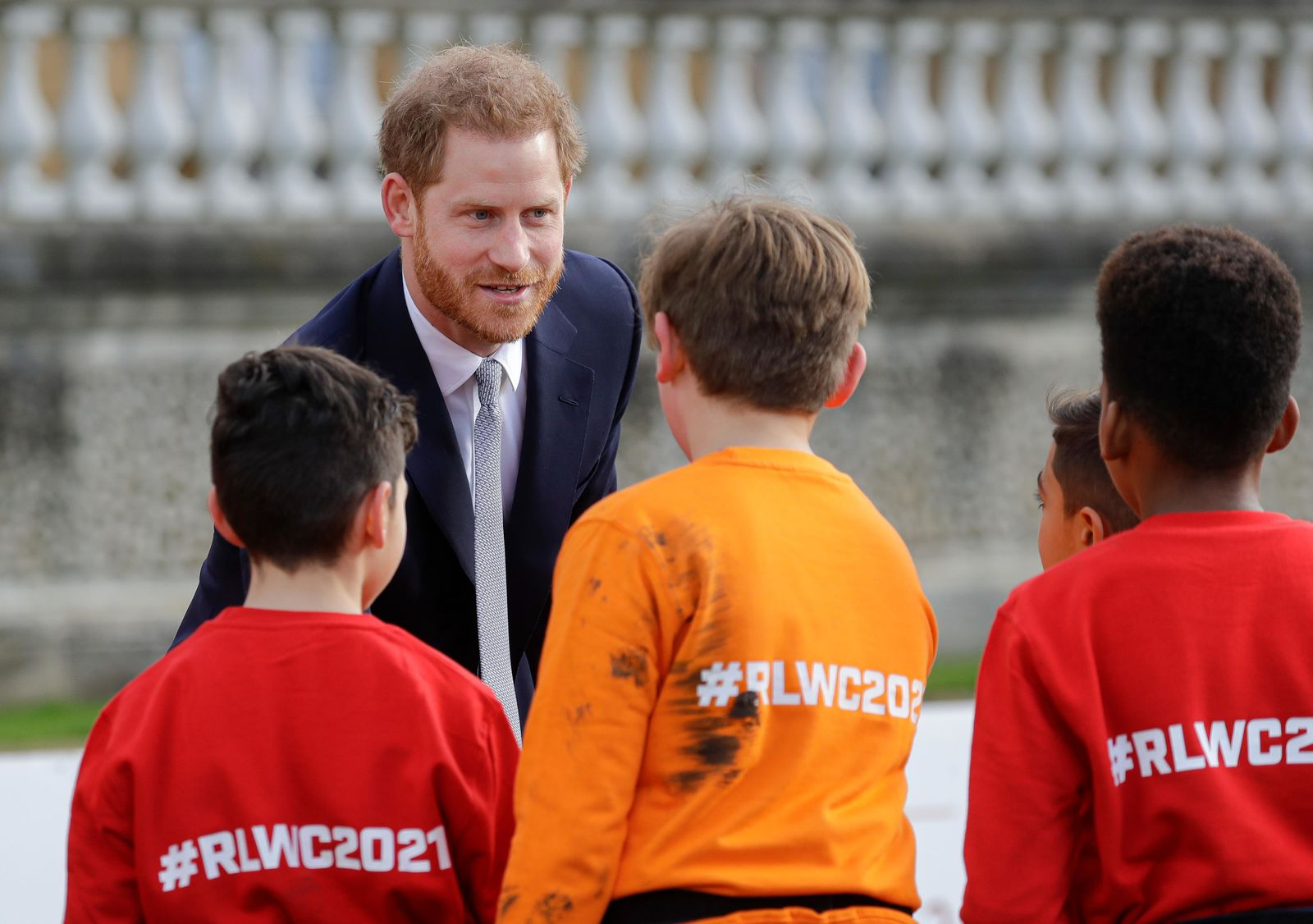 Britain's Prince Harry greets schoolchildren in the gardens at Buckingham Palace in London, Thursday, Jan. 16, 2020.{ } (AP Photo/Kirsty Wigglesworth)