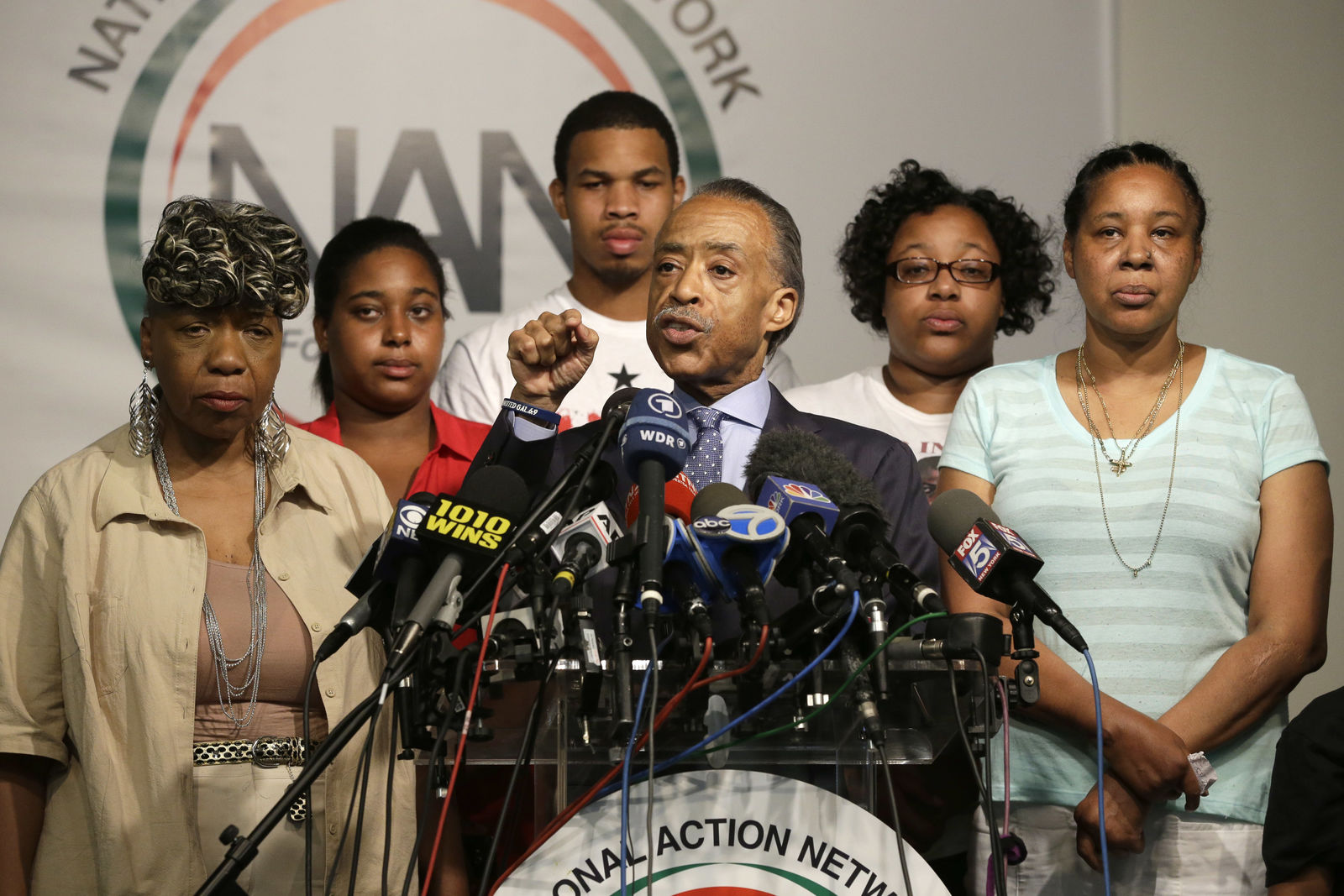 The Rev. Al Sharpton, center, is joined by Eric Garner's mother Gwen Carr, left, daughter Erica Garner, second from left, son Eric Garner, third from left, daughter Emerald Snipes, second from right, and wife Esaw Snipes, as he speaks during a news conference, Tuesday, July 14, 2015, in New York. (AP Photo/Mary Altaffer)
