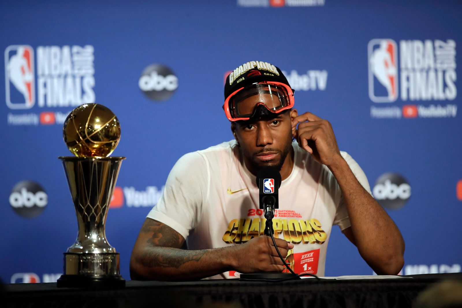 Toronto Raptors forward Kawhi Leonard speaks at a news conference alongside the NBA Finals Most Valuable Player trophy after the Raptors defeated the Golden State Warriors in Game 6 of basketball's NBA Finals in Oakland, Calif., Thursday, June 13, 2019. (AP Photo/Ben Margot)