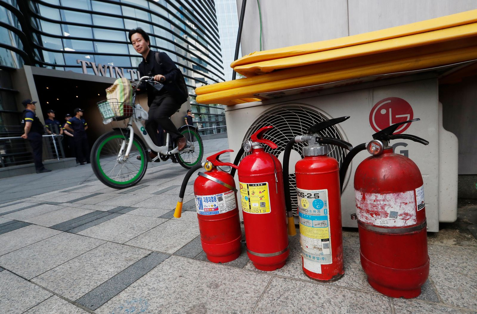Fire extinguishers are placed near a building where the Japanese embassy is located in Seoul, South Korea, Friday, July 19, 2019. (AP Photo/Ahn Young-joon)