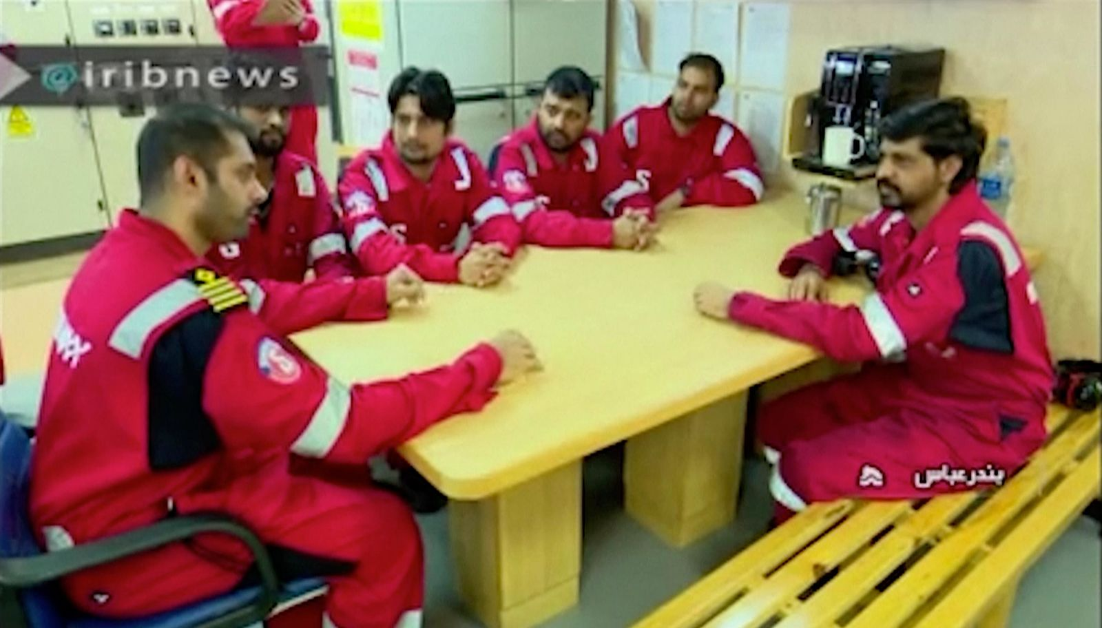 In this photo released by state-run IRIB News Agency, which aired on Monday, July 22, 2019, shows various crew members of the British-flagged tanker Stena Impero, that was seized by Tehran in the Strait of Hormuz on Friday, during a meeting. (IRIB News Agency via AP)