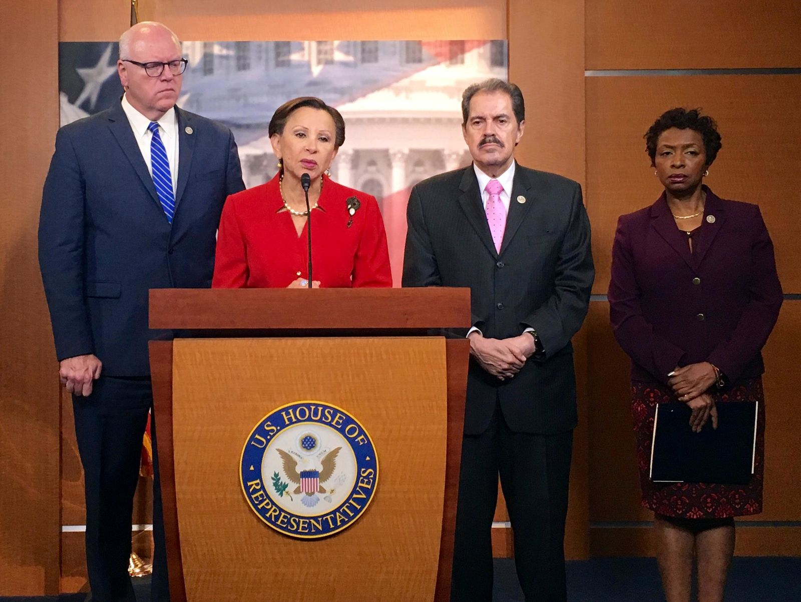 From left, New York Reps. Joe Crowley, Nydia Velazquez, Jose Serrano and Yvette Clarke talk about the damage in Puerto Rico caused by Hurricane Maria on Capitol Hill in Washington, Tuesday, Sept. 26, 2017. (AP Photo/Matthew Daly)