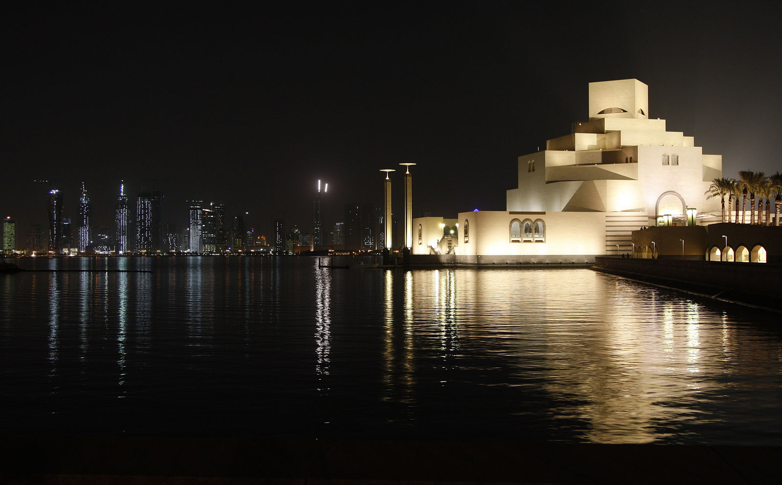FILE - This Dec. 1, 2008, file photo shows The Museum of Islamic Art, foreground, designed by American architect I.M. Pei, and the skyline of Doha, Qatar. Pei, the globe-trotting architect who revived the Louvre museum in Paris with a giant glass pyramid and captured the spirit of rebellion at the multi-shaped Rock and Roll Hall of Fame, has died at age 102, a spokesman confirmed Thursday, May 16, 2019. (AP Photo/Hassan Ammar, File)