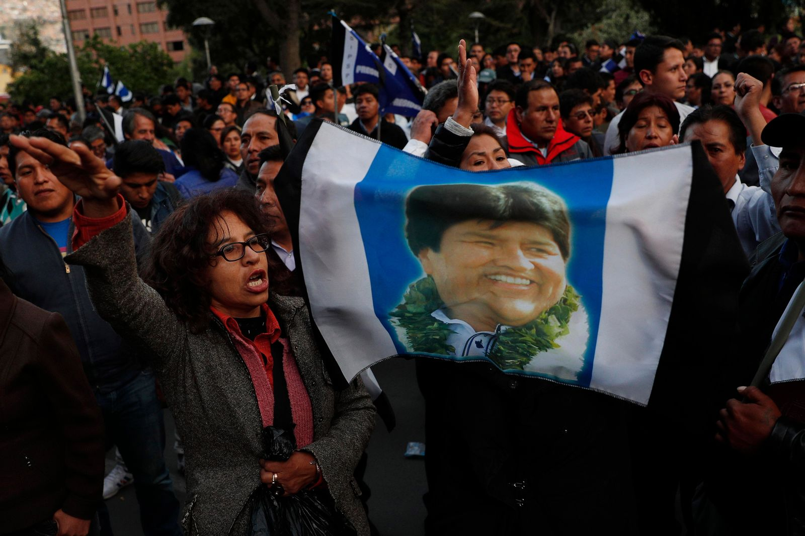 Supporters of Bolivian President Evo Morales, who is running for a fourth term, rally outside the Supreme Electoral Court where election ballots are being counted in La Paz, Bolivia, Monday, Oct. 21, 2019.{ } (AP Photo/Juan Karita)