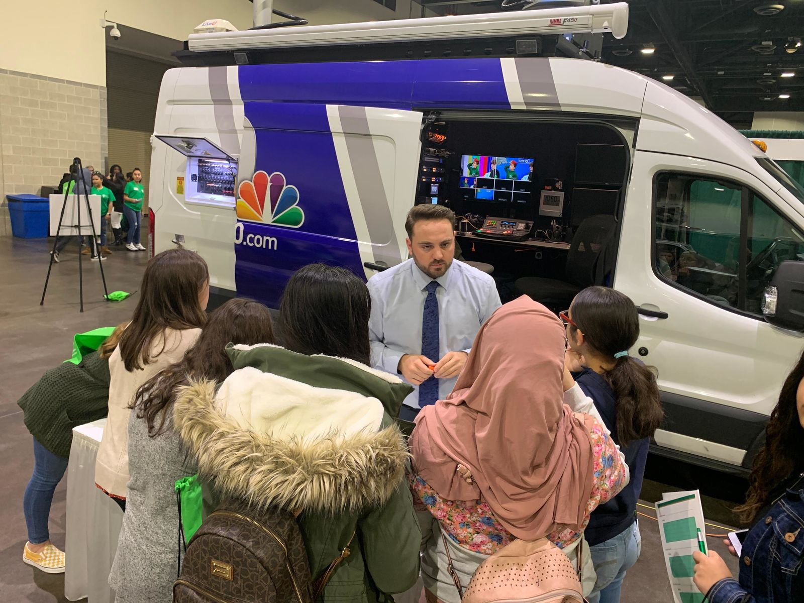 Jon Shideler, who works in the promotions department at NBC 10, chats with students. (WJAR)