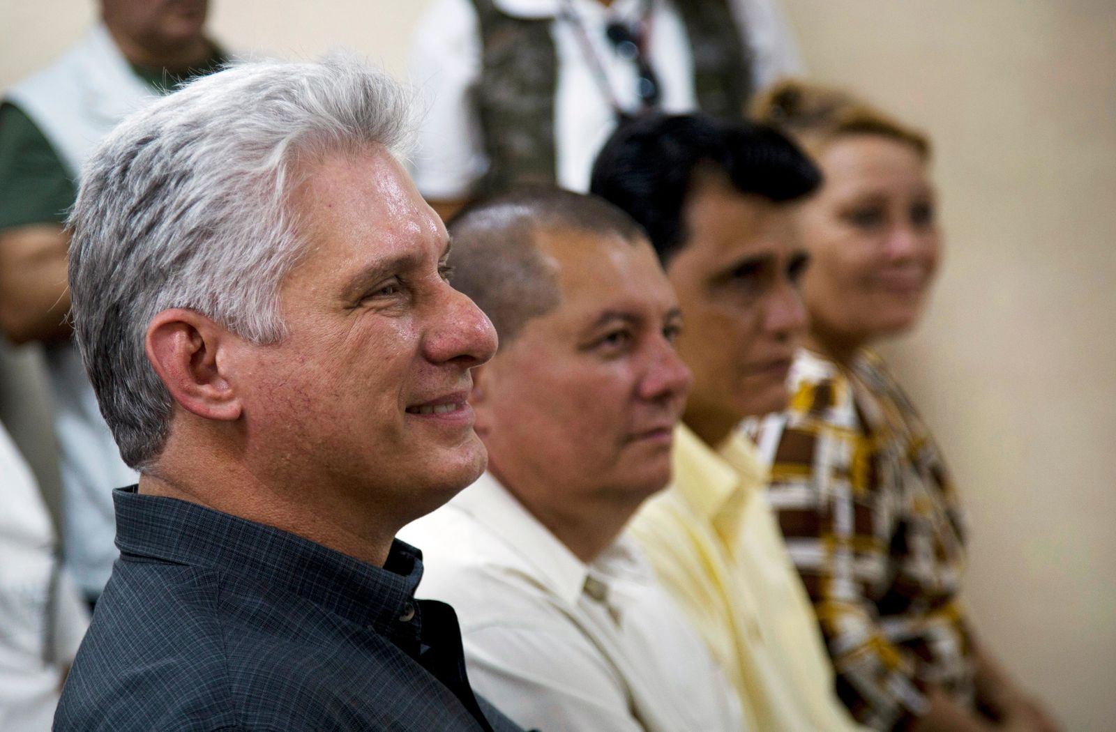 Cuba's President Miguel Diaz-Canel, left, attends a meeting in an art school during a tour in Las Tunas, Cuba, Thursday, Jan. 16, 2020. (AP Photo/Ismael Francisco)