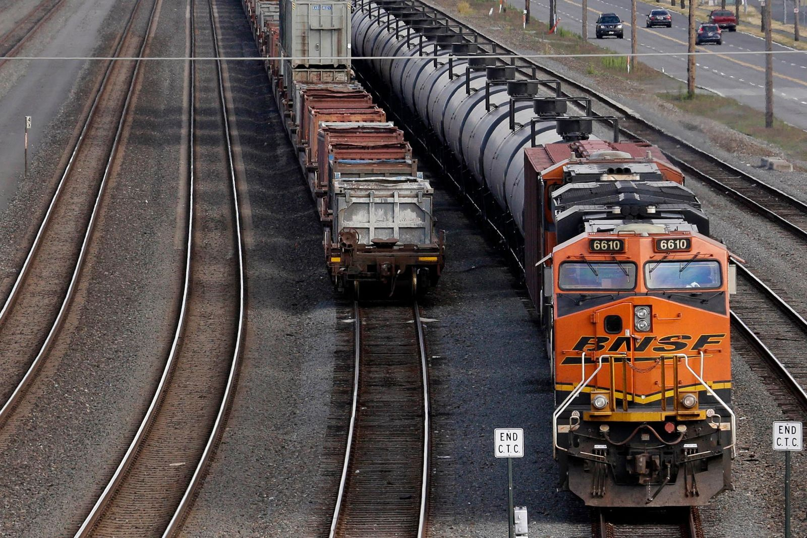 FILE - In this July 27, 2015, file photo, a BNSF Railway Company train is parked in Seattle. More than two dozen major companies ranging from Campbell Soup to Kia filed anti-trust lawsuits on Sept. 30, 2019 against the nation's four largest railway companies, contending the railroads had a price-fixing scheme to illegally boost profits.(AP Photo/Elaine Thompson, File)