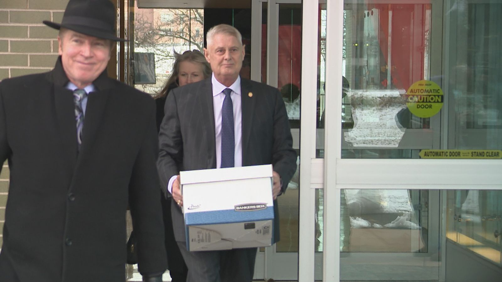Rep. Larry Inman walked out of court Tuesday, Dec. 3 after the first day of his federal bribery trial. (WWMT/Jason Heeres)