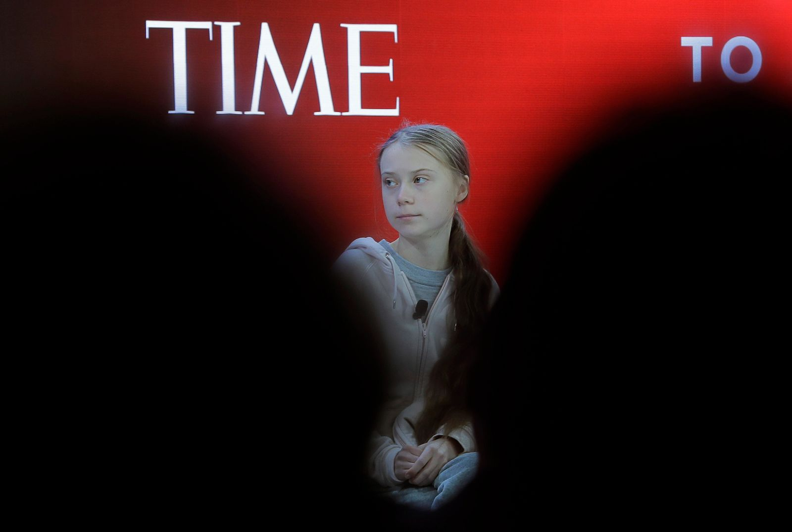 Swedish environmental activist Greta Thunberg takes her seat prior to the opening session of the World Economic Forum in Davos, Switzerland, Tuesday, Jan. 21, 202(AP Photo/Markus Schreiber)
