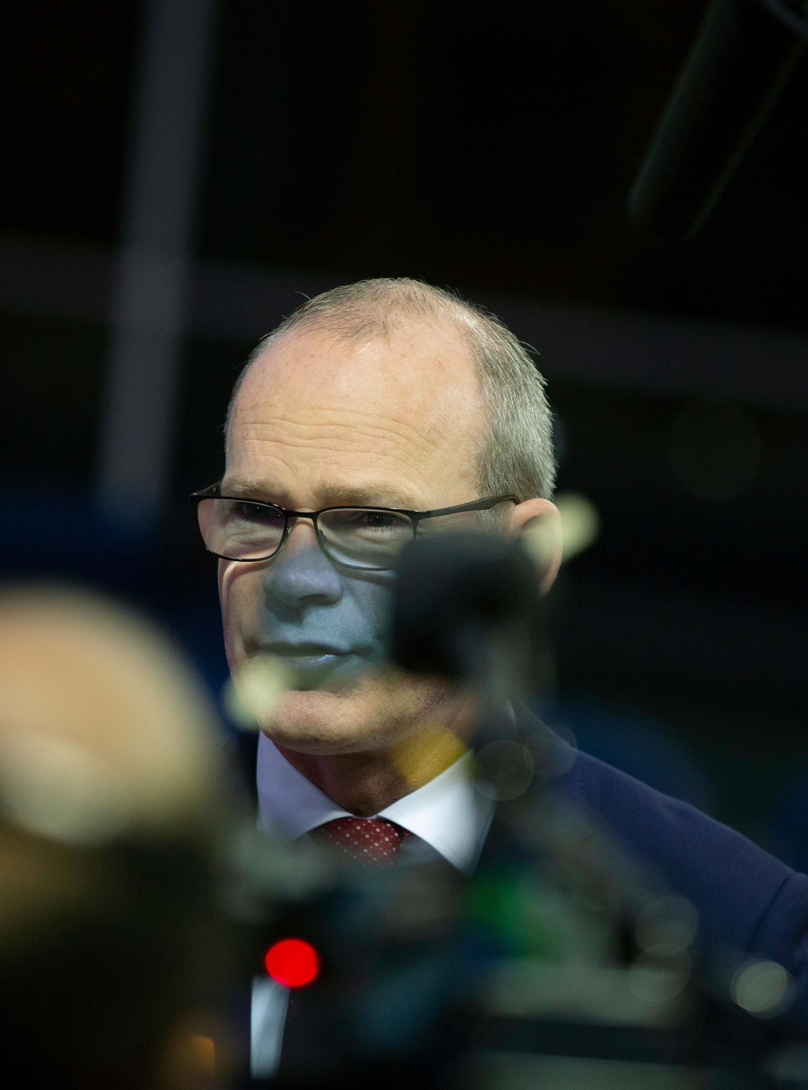 Irish Foreign Minister Simon Coveney speaks with the media as he arrives for a meeting of EU foreign ministers at the European Convention Center in Luxembourg, Monday, Oct. 14, 2019.{ } (AP Photo/Virginia Mayo)