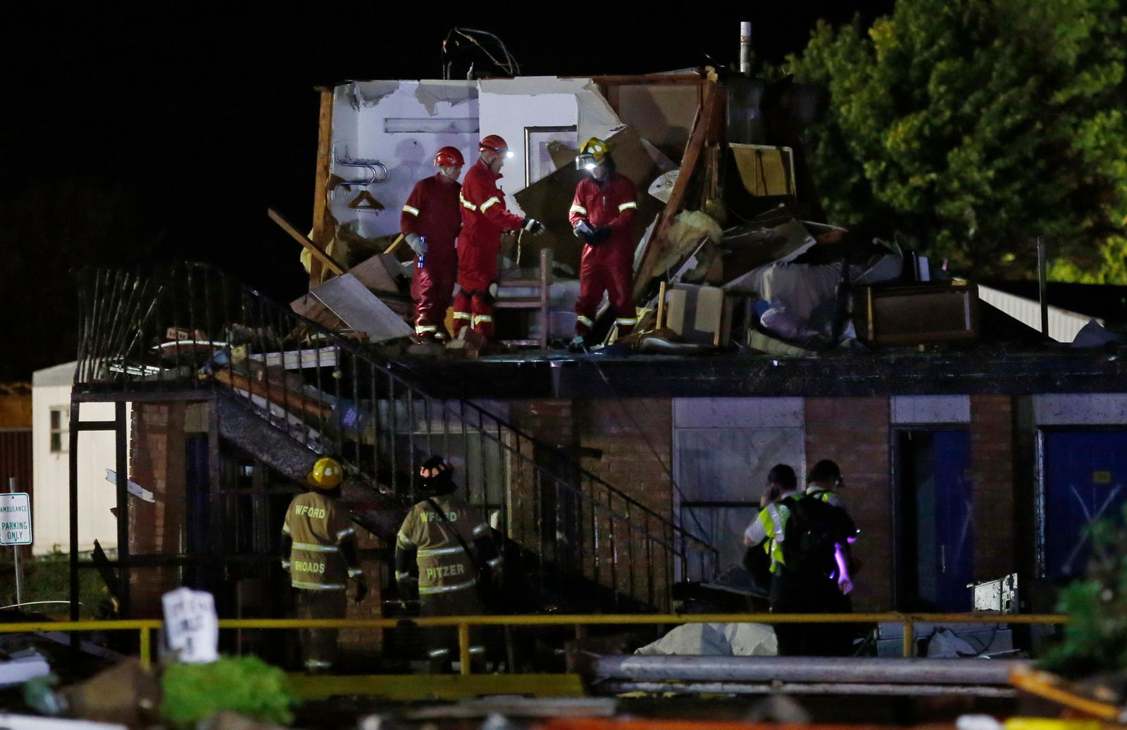 Emergency workers check what is left of the second floor of a hotel, Sunday, May 26, 2019, in El Reno, Ok., following a likely tornado touchdown late Saturday night. (AP Photo/Sue Ogrocki)