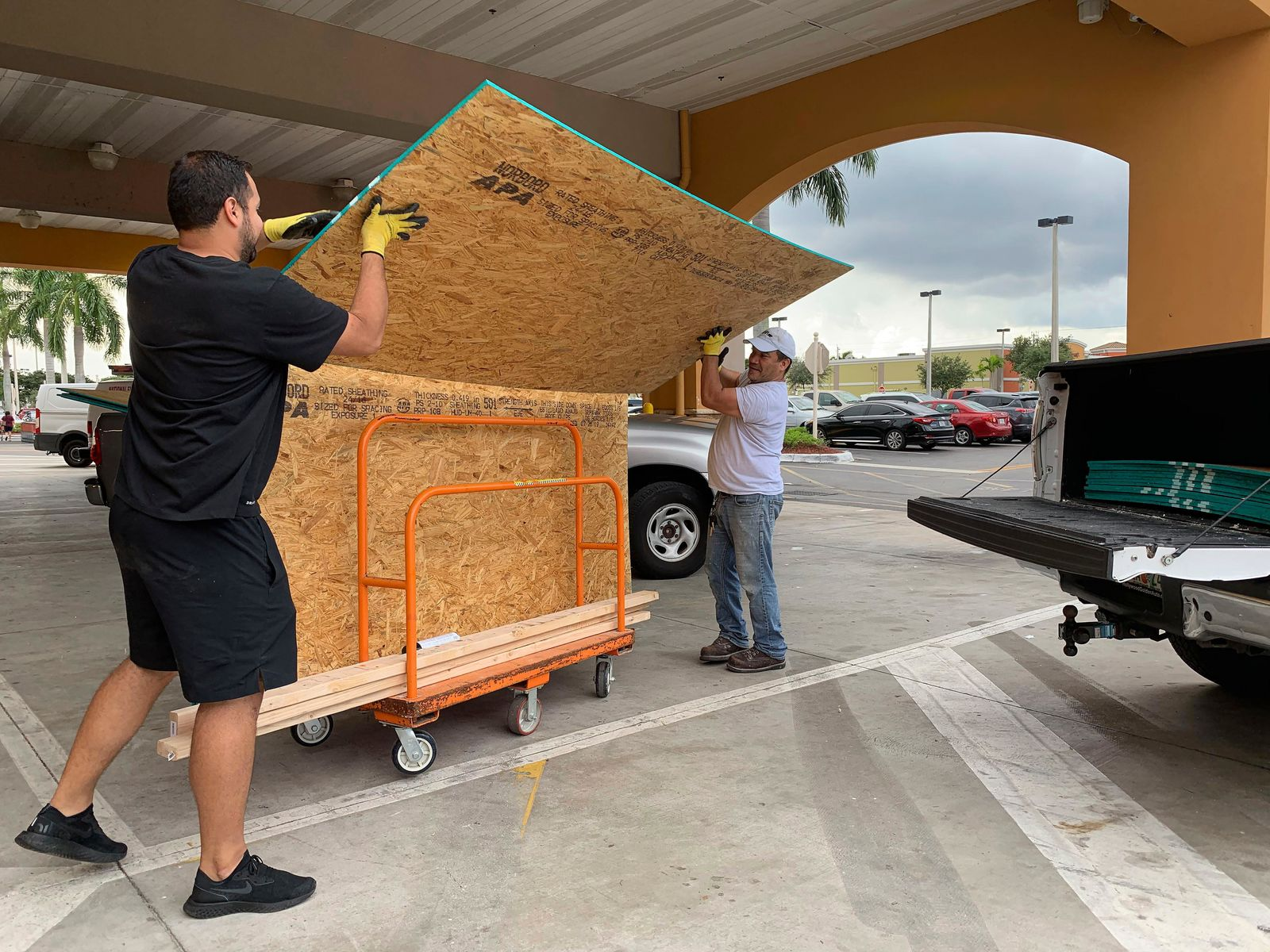Shoppers load their truck with supplies to prepare ahead of Hurricane Dorian at The Home Depot on Thursday, Aug. 29, 2019, in Pembroke Pines, Fla. (AP Photo/Brynn Anderson)