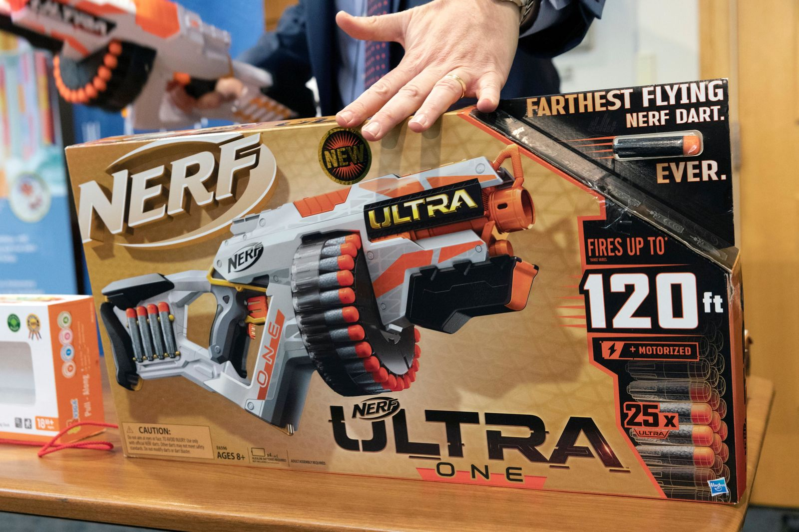 James Swartz, director of World Against Toys Causing Harm, talks about the dangers of the Nerf Ultra One, during a news conference in Boston, Tuesday, Nov. 19, 2019. The organization says the Nerf Ultra One gun, which is billed as firing soft darts up to 120 feet, shoots the projectiles with enough force to potentially cause eye injuries. (AP Photo/Michael Dwyer)