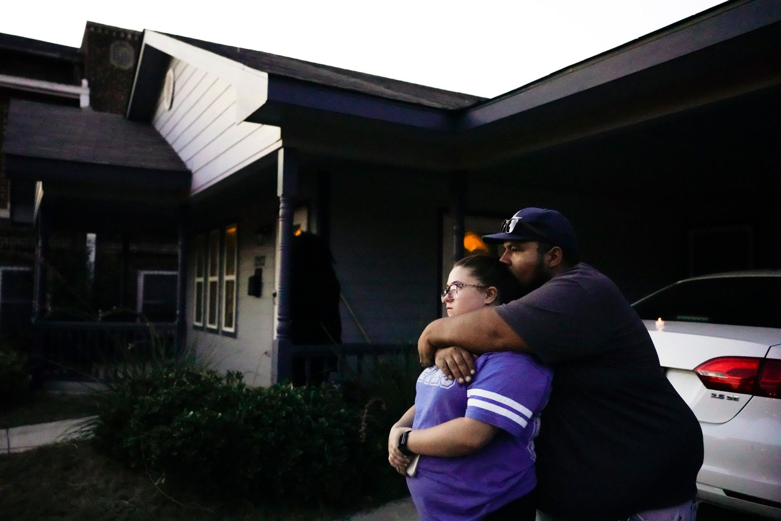 Destinie and Floriberto Bartolo mourn for their friend Atatiana Jefferson, who they say they have known since high school, outside the house where Jefferson was shot and killed by a police officer, during a community vigil for Jefferson on Sunday, Oct. 13, 2019, in Fort Worth, Texas. (Smiley N. Pool/The Dallas Morning News via AP)