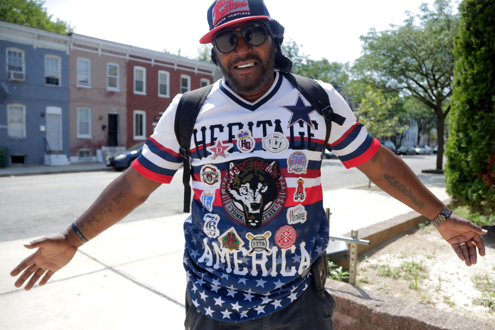 Victor Toulson, 50, displays his patriotic shirt outside of the Sandtown-Winchester Senior Center, Monday, July 29, 2019, in the Sandtown section of Baltimore. (AP Photo/Julio Cortez)