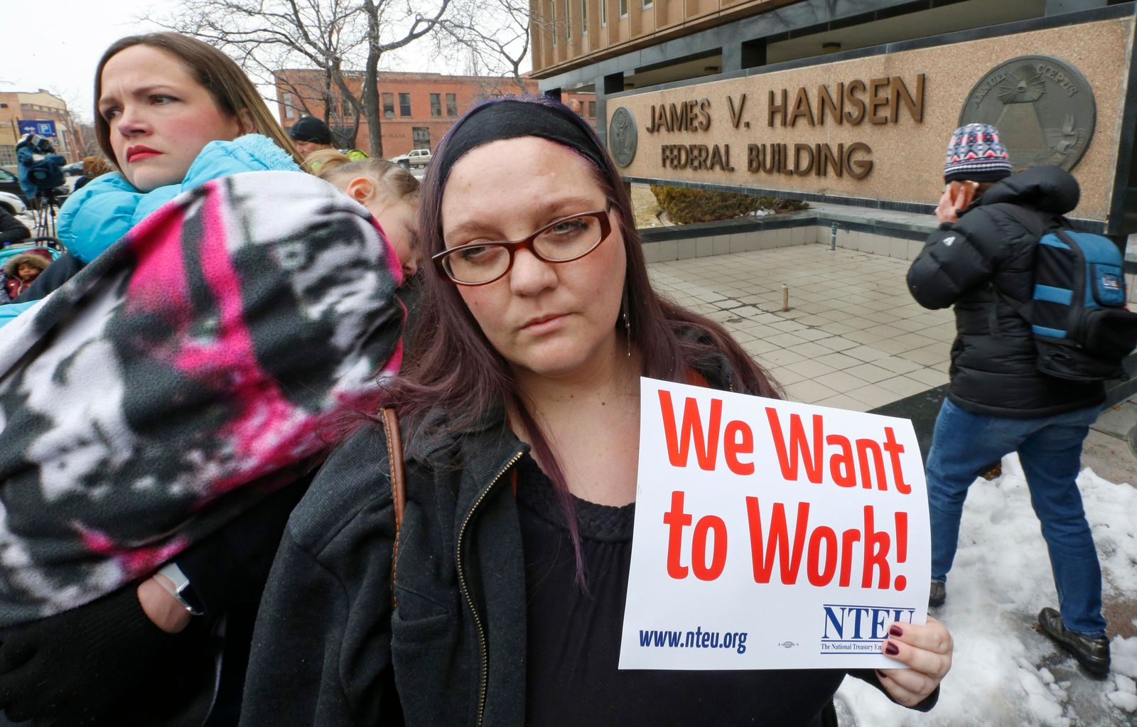 IRS worker Christine Helquist joins a federal workers protest rally outside the Federal Building, Thursday, Jan., 10, 2019, in Ogden, Utah. (AP Photo/Rick Bowmer)