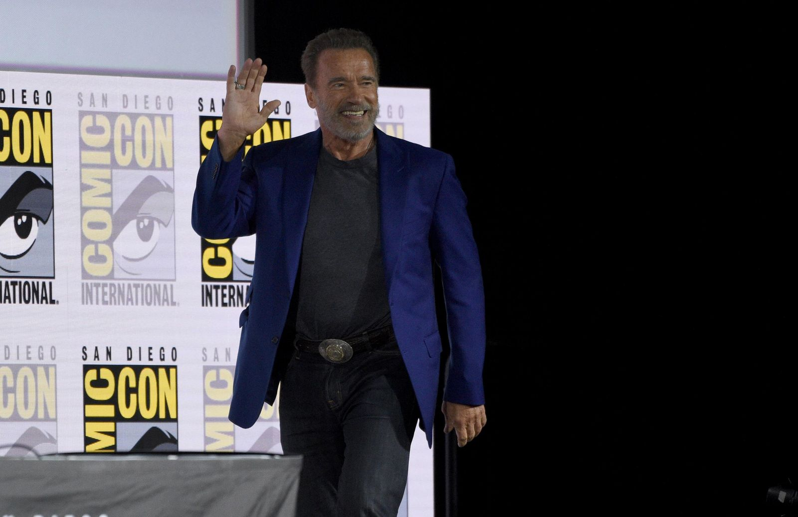 "Arnold Schwarzenegger walks on stage at the ""Terminator: Dark Fate"" panel on day one of Comic-Con International on Thursday, July 18, 2019, in San Diego. (Photo by Chris Pizzello/Invision/AP)"