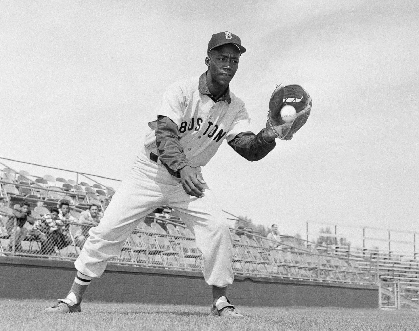 "FILE - In this April 1959 file photo, Boston Red Sox's Elijah ""Pumpsie"" Green poses for a photo, location not known. Green, the first black player on the Red Sox, has died. He was 85. A Red Sox spokesman confirmed his death Wednesday night, July 17, 2019. (AP Photo/Harold Filan, File)"