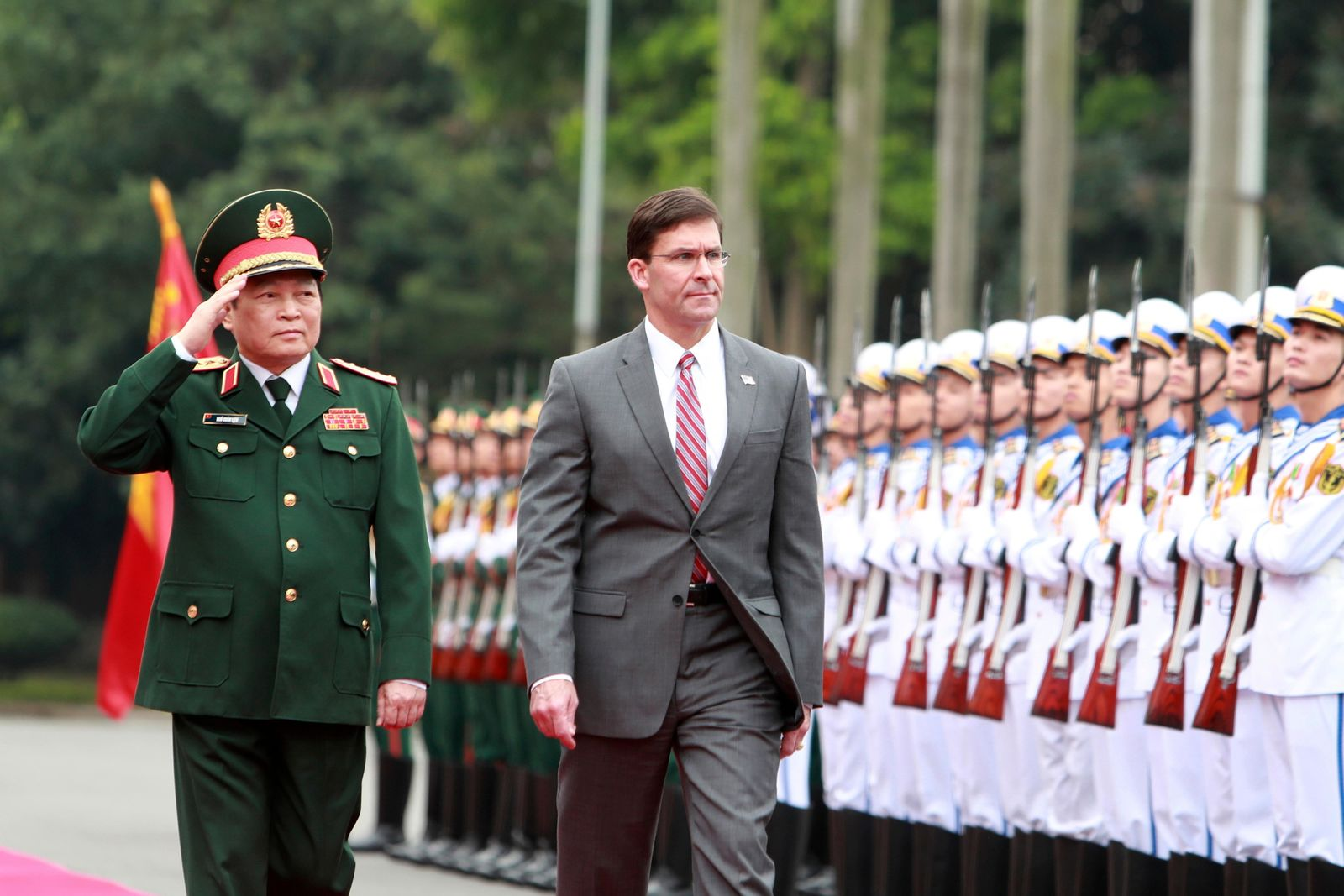 U.S. SDefense Secretary Mark Esper, right, and Vietnamese Defense Minister Ngo Xuan Lich review an honor guard in Hanoi, Vietnam on Wednesday, Nov. 20, 2019. (AP Photo/Hau Dinh)