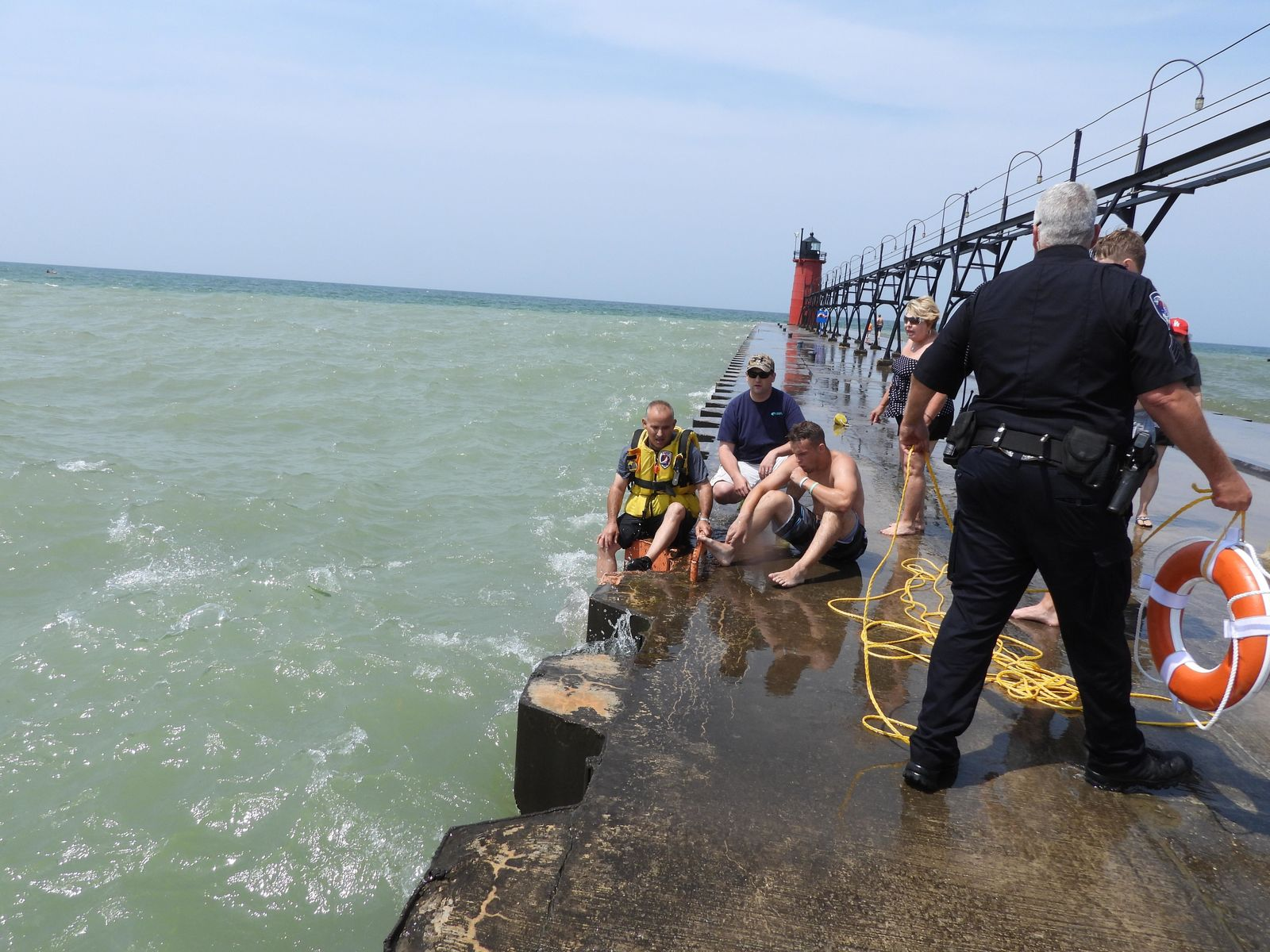 An 18-year-old boy was rescued by officials with the South Haven Area Emergency Services on Friday, after being caught in a rip tide along the South Pier. (WWMT/Courtesy of South Haven Area Emergency Services)<p></p>