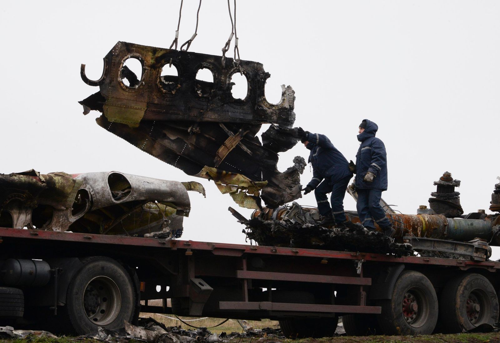 FILE - In this file photo dated Sunday, Nov. 16, 2014, recovery workers in rebel-controlled eastern Ukraine load debris from the crash site of Malaysia Airlines Flight 17, in Hrabove, Ukraine, with recovery operations carried out under the supervision of Dutch investigators and officials from the Organization for Security and Cooperation in Europe.(AP Photo/Mstyslav Chernov, FILE)