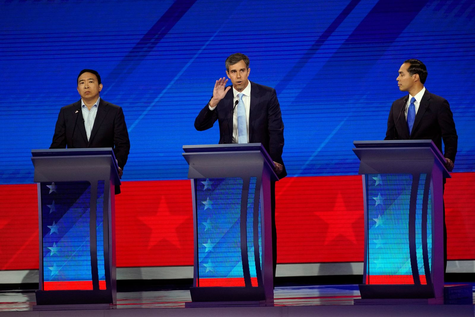Andrew Yang, left, and former Housing and Urban Development Secretary Julian Castro, right, listen to former Texas Rep. Beto O'Rourke, center, Thursday, Sept. 12, 2019, during a Democratic presidential primary debate hosted by ABC at Texas Southern University in Houston. (AP Photo/David J. Phillip)