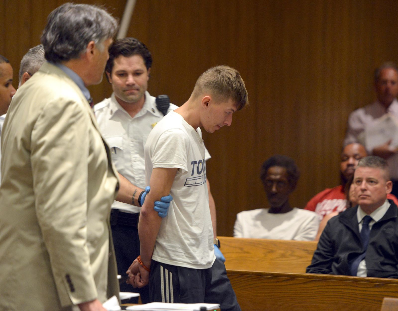 Volodymyr Zhukovskyy, 23, of West Springfield, stands during his arraignment in Springfield District Court, Monday, June 24, 2019, in Springfield, Mass. Zhukovskyy, the driver of a truck in a fiery collision on a rural New Hampshire highway that killed seven motorcyclists, was charged Monday with seven counts of negligent homicide. (Don Treeger/The Republican via AP, Pool)