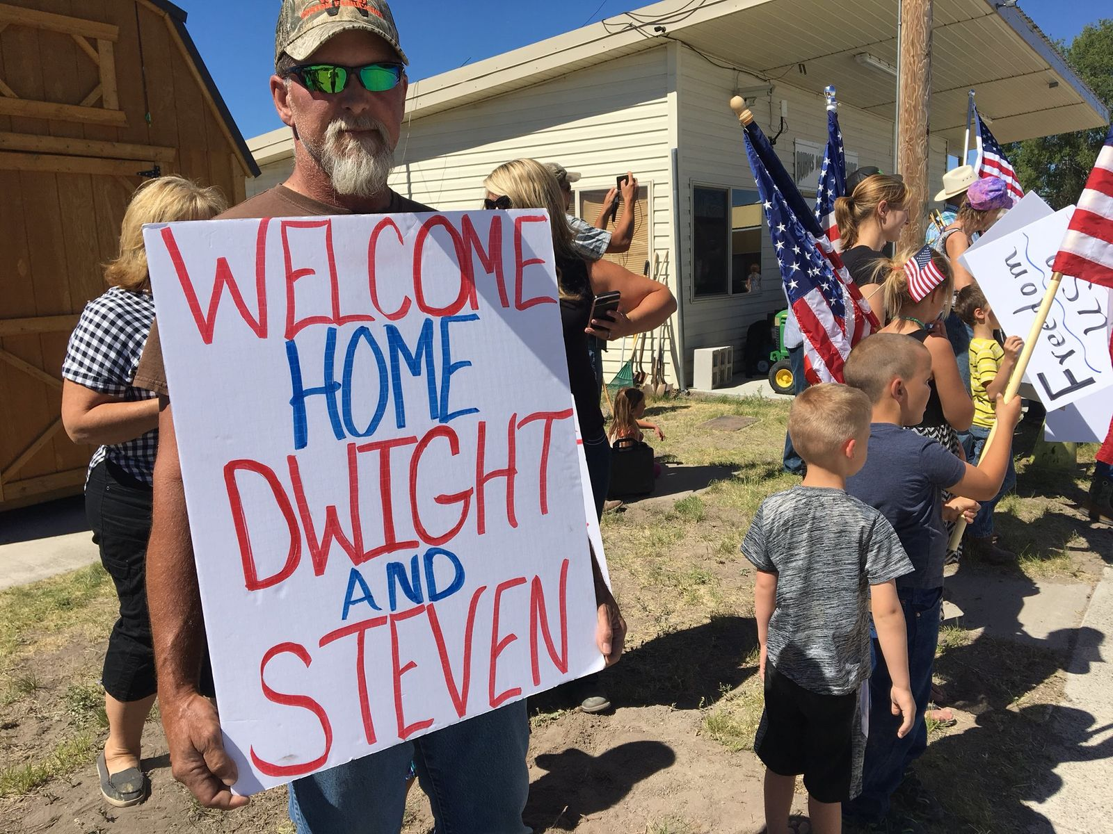 An eager crowd waited for Dwight and Steven Hammond to arrive home at a small airport in Burns, Oregon on July 11, 2018. President Donald Trump pardoned the arson sentences of the father and son ranchers on July 10, 2018. The two were accused of setting a fire on Bureau of Land Management property to hide evidence of game violation and were sentenced to five years in prison. KATU photo