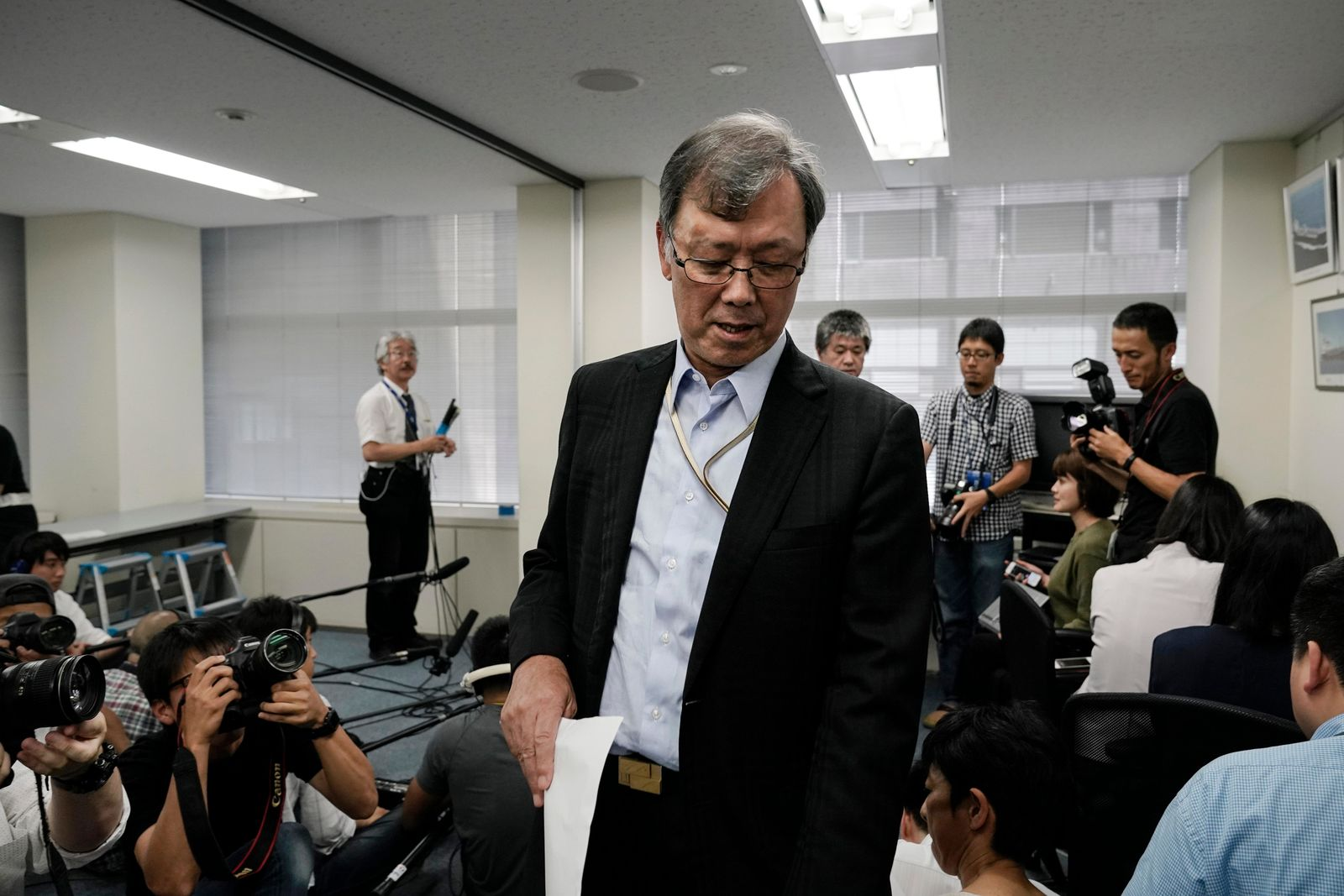 Yutaka Katada, president of Kokuka Sangyo Co., the Japanese company operating one of two oil tankers attacked near the Strait of Hormuz, leaves the room after speaking to reporters at a news conference Friday, June 14, 2019, in Tokyo. Iran rejects a U.S. accusation against Tehran over suspected attacks on two oil tankers near the strategic Strait of Hormuz. (AP Photo/Jae C. Hong)