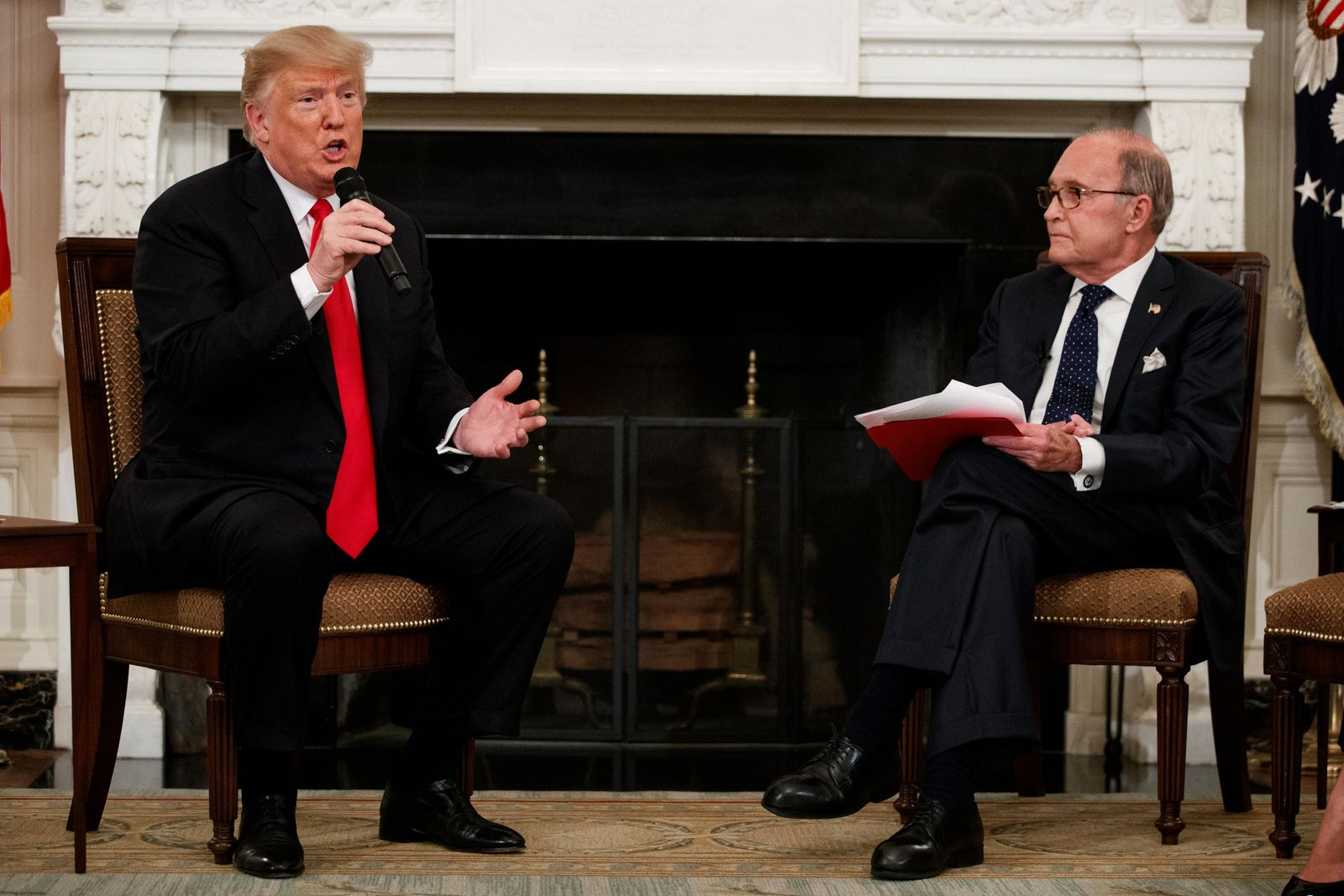 "White House chief economic adviser Larry Kudlow listens as President Donald Trump speaks during the ""Our Pledge to America's Workers"" event in the State Dining Room of the White House, Wednesday, Oct. 31, 2018, in Washington. (AP Photo/Evan Vucci)"
